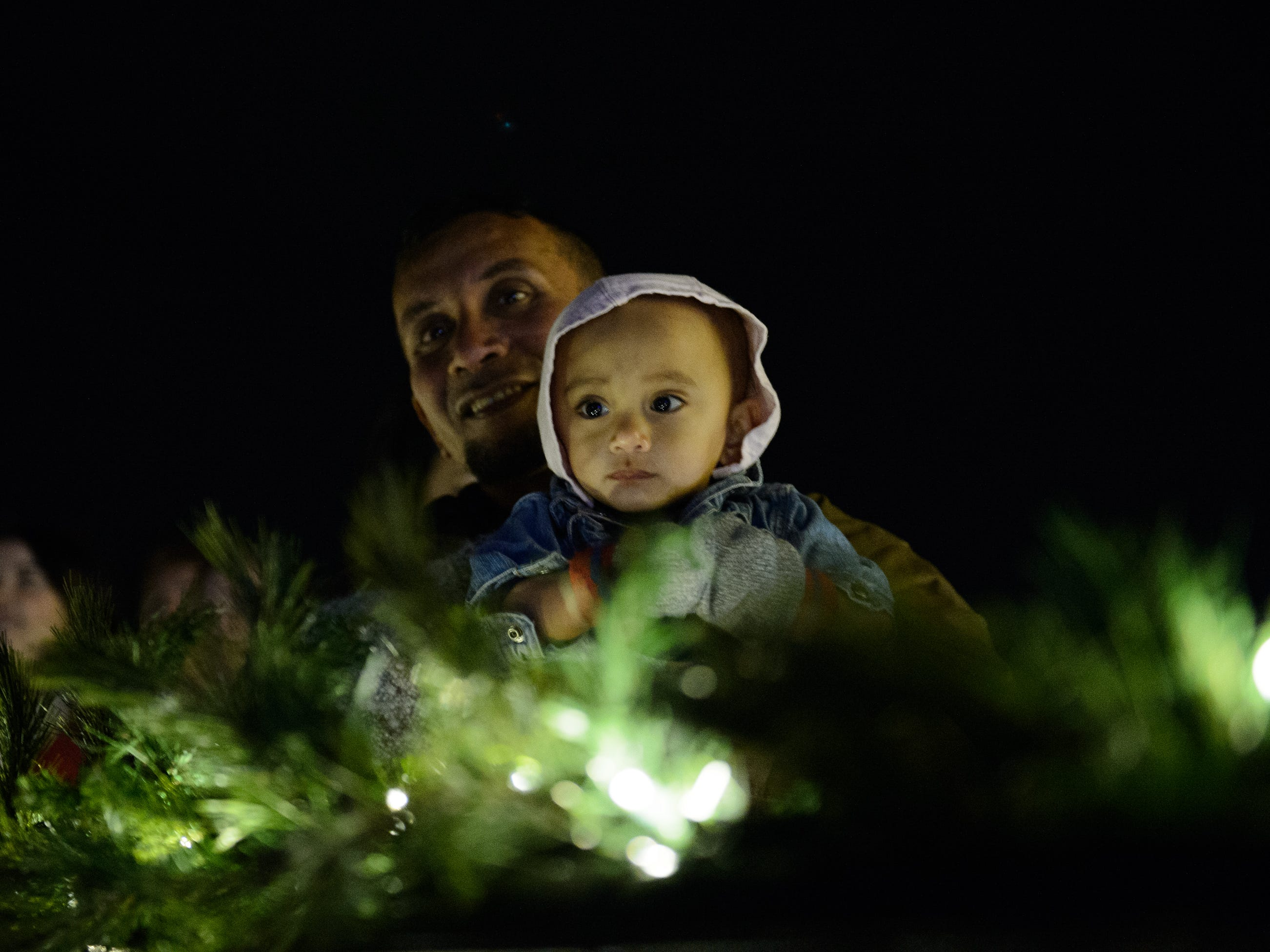 Michael Charlie and his 1-year-old daughter Hannah Grace watch the choir sing at Bob Jones University's annual Christmas Celebration on Friday, Nov. 30, 2018.
