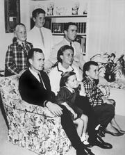 In this 1964 file photo, George H.W. Bush sits on couch with his wife, Barbara, and their children. George W. Bush sits at right, behind his mother. Behind couch are Neil and Jeb Bush. Sitting with parents are Dorothy and Marvin Bush.