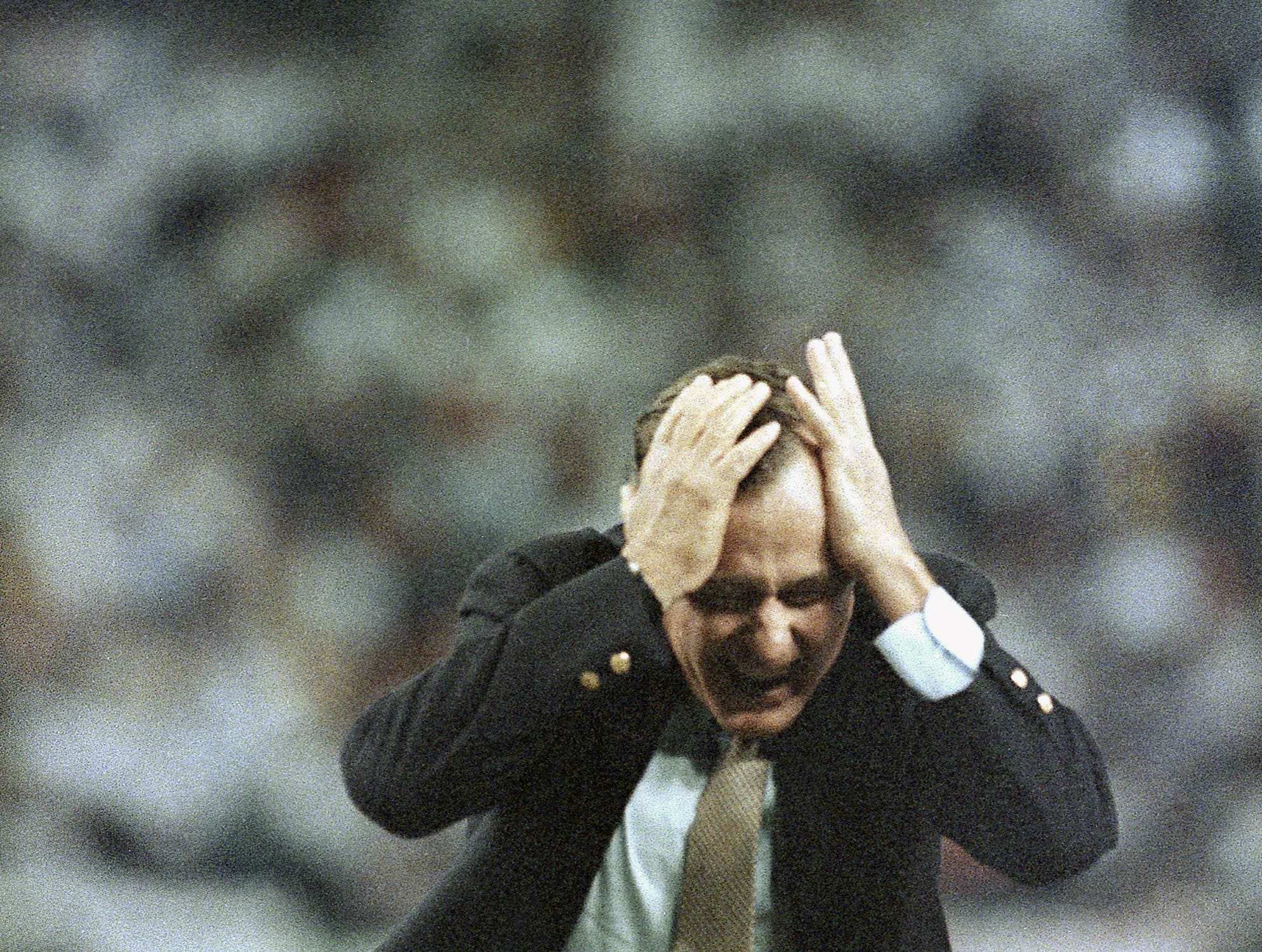 Vice President George H. W. Bush reacts to his bouncing pitch during pre game ceremonies of the National League playoff game, Wednesday, Oct. 8, 1986, Houston, Tex. (AP Photo/Ron Heflin)