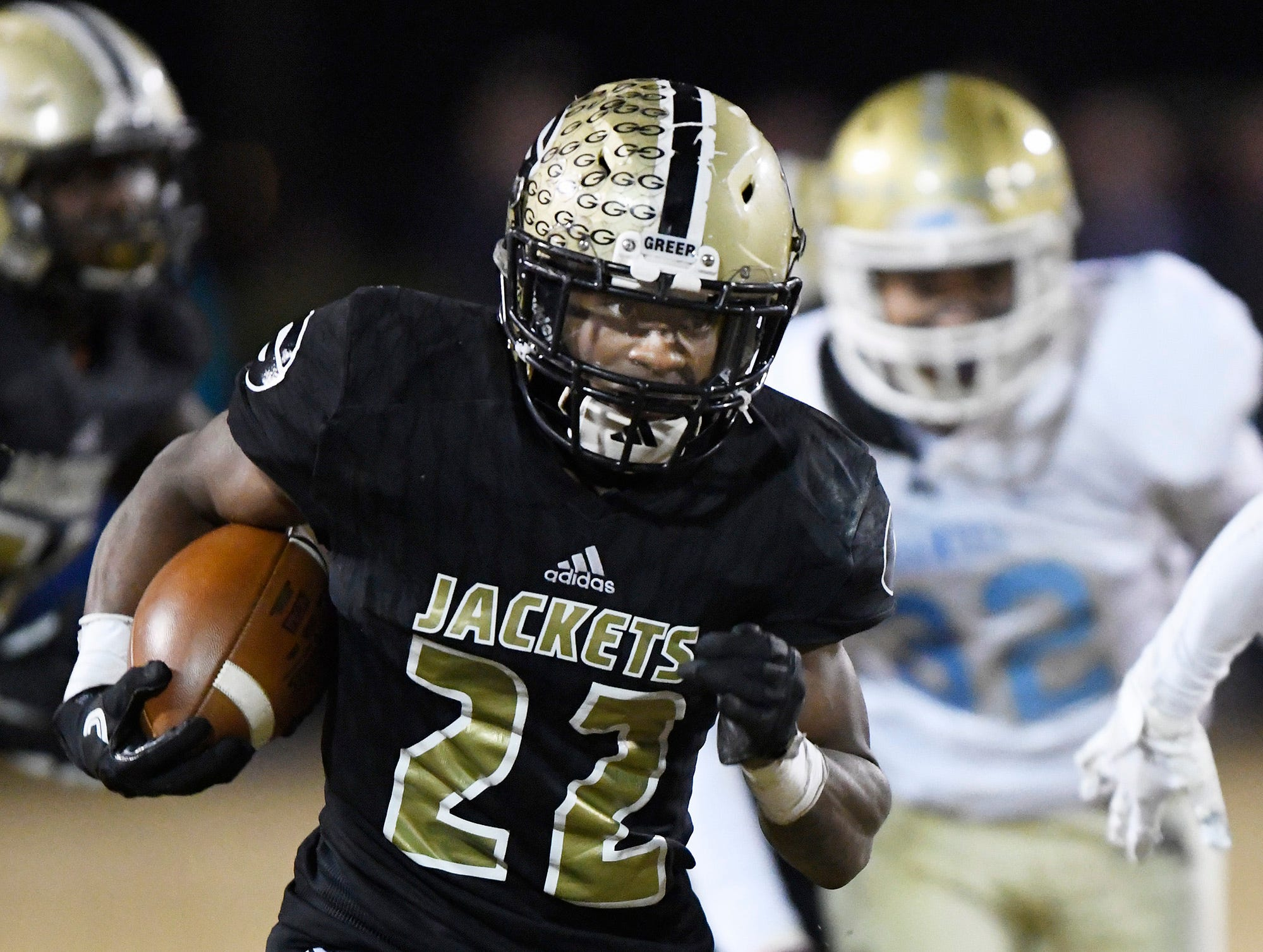 Greer's Dre Williams (22) takes off for touchdown against Daniel in the class AAAA upstate championship Friday, November 30, 2018 at Greer's Dooley Field.