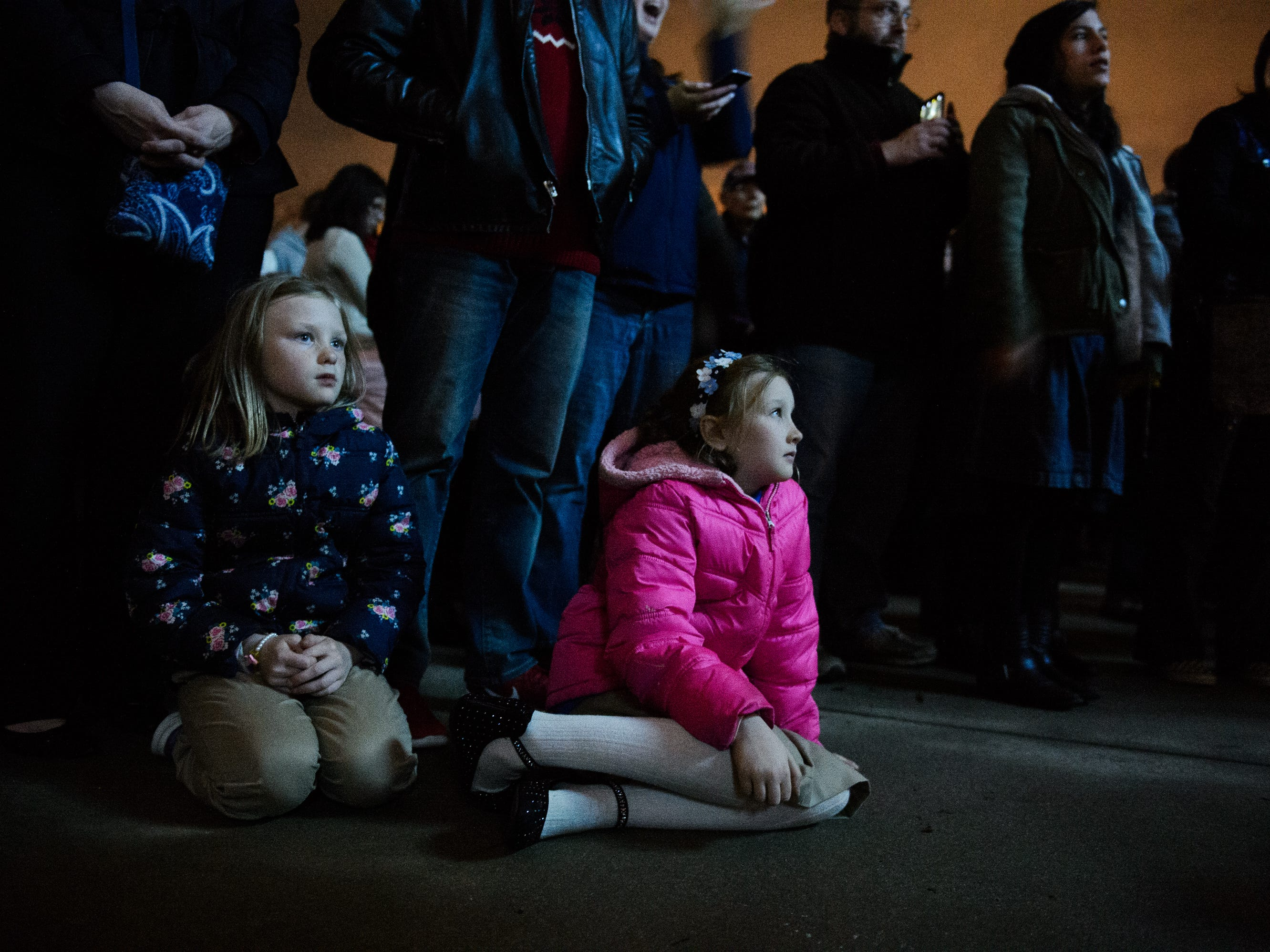 Noel Boudreau 8, and her sister Evelyn, 9, watch the choir sing at Bob Jones University's annual Christmas Celebration on Friday, Nov. 30, 2018.
