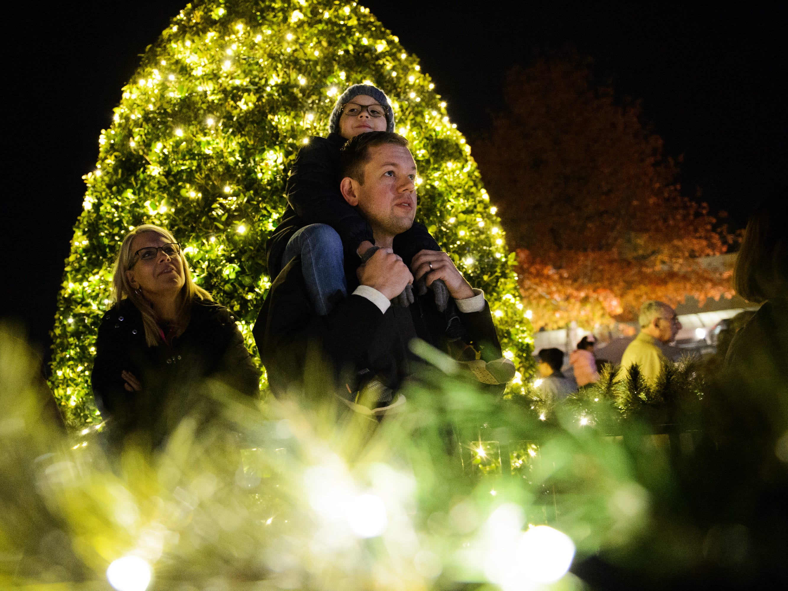 Chris Jenkins and his 6-year-old son Liam watch the choir sing at Bob Jones University's annual Christmas Celebration on Friday, Nov. 30, 2018.