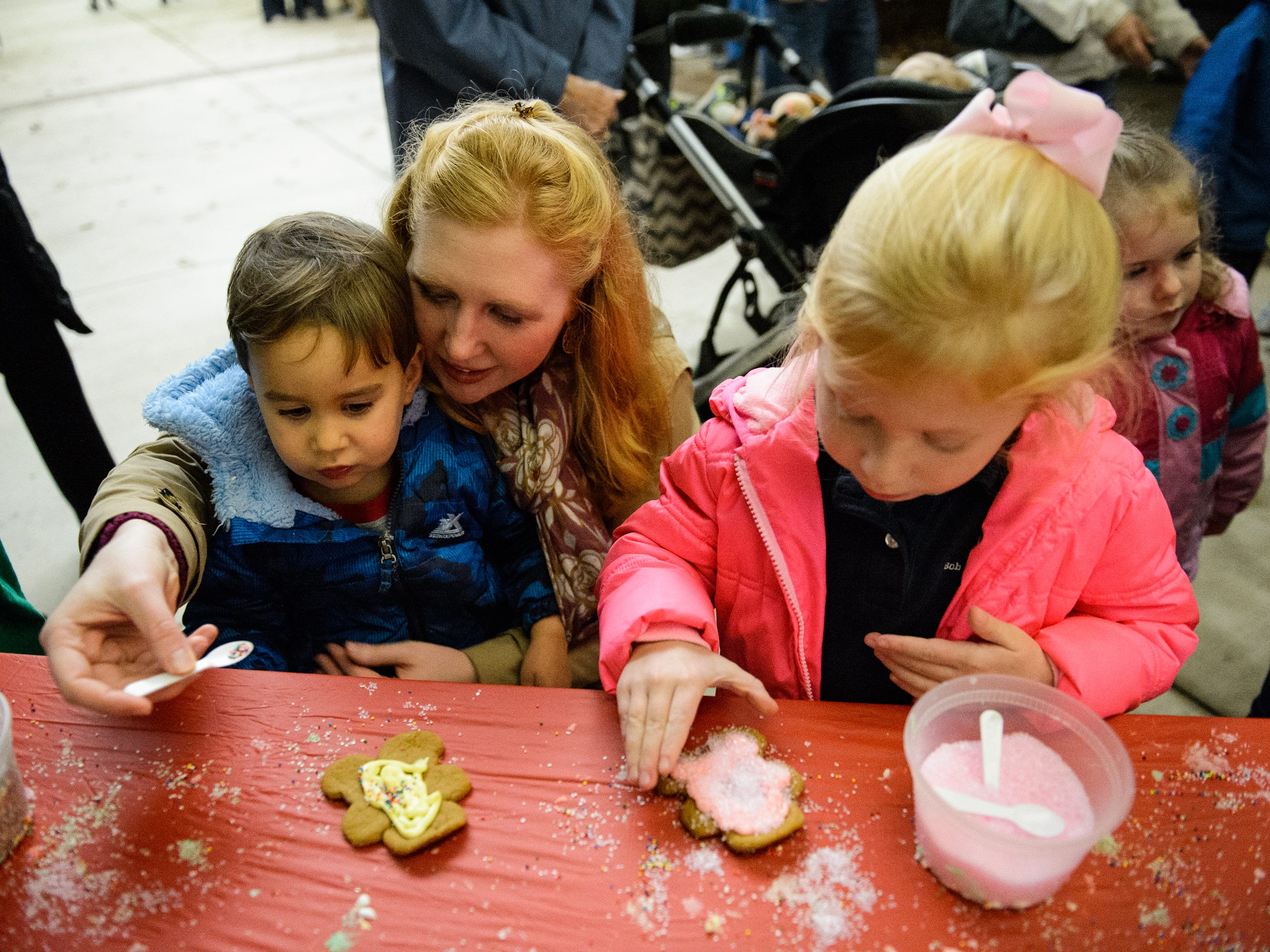 Kristin Villalba makes Christmas cookies with her children Sabrina, 4, and Matias, 2, at Bob Jones University's annual Christmas Celebration on Friday, Nov. 30, 2018.