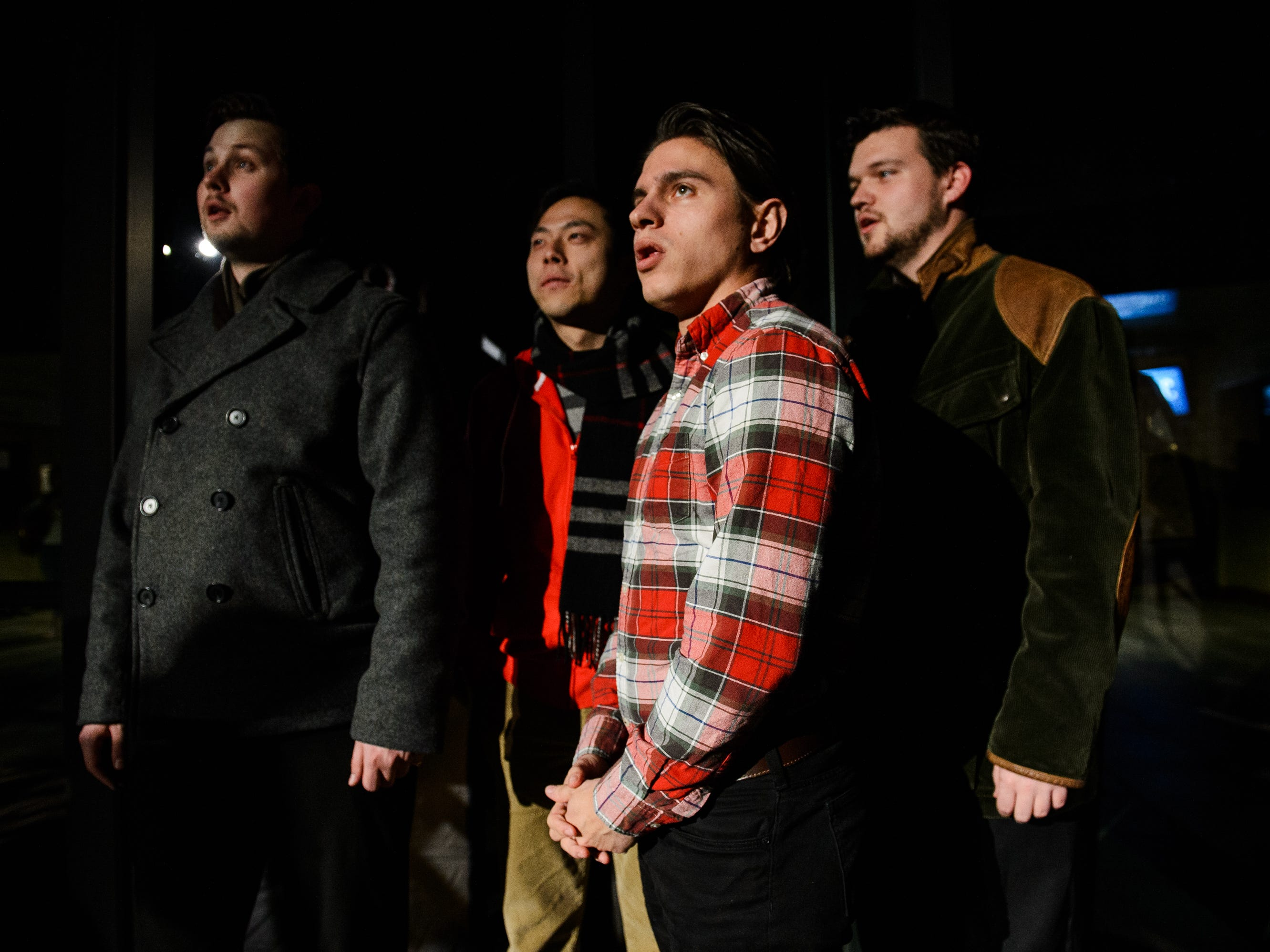 From left, Michael Seibert, Peter Xia, Jacob Martin and Joel Dupont sing along to a Christmas carol at Bob Jones University's annual Christmas Celebration on Friday, Nov. 30, 2018.