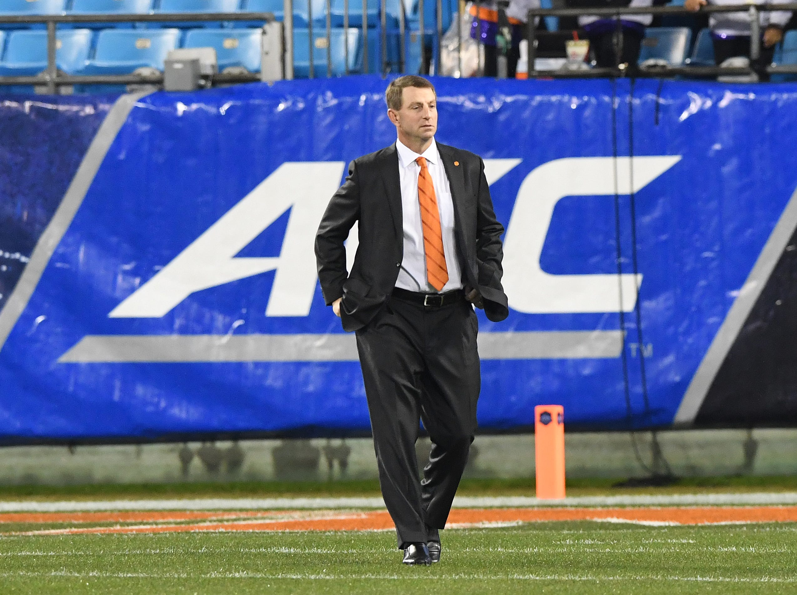 Clemson head coach Dabo Swinney walks the field after arriving at Bank of America Stadium in Charlotte, N.C. for the Dr. Pepper ACC Championship Saturday, December 1, 2017.