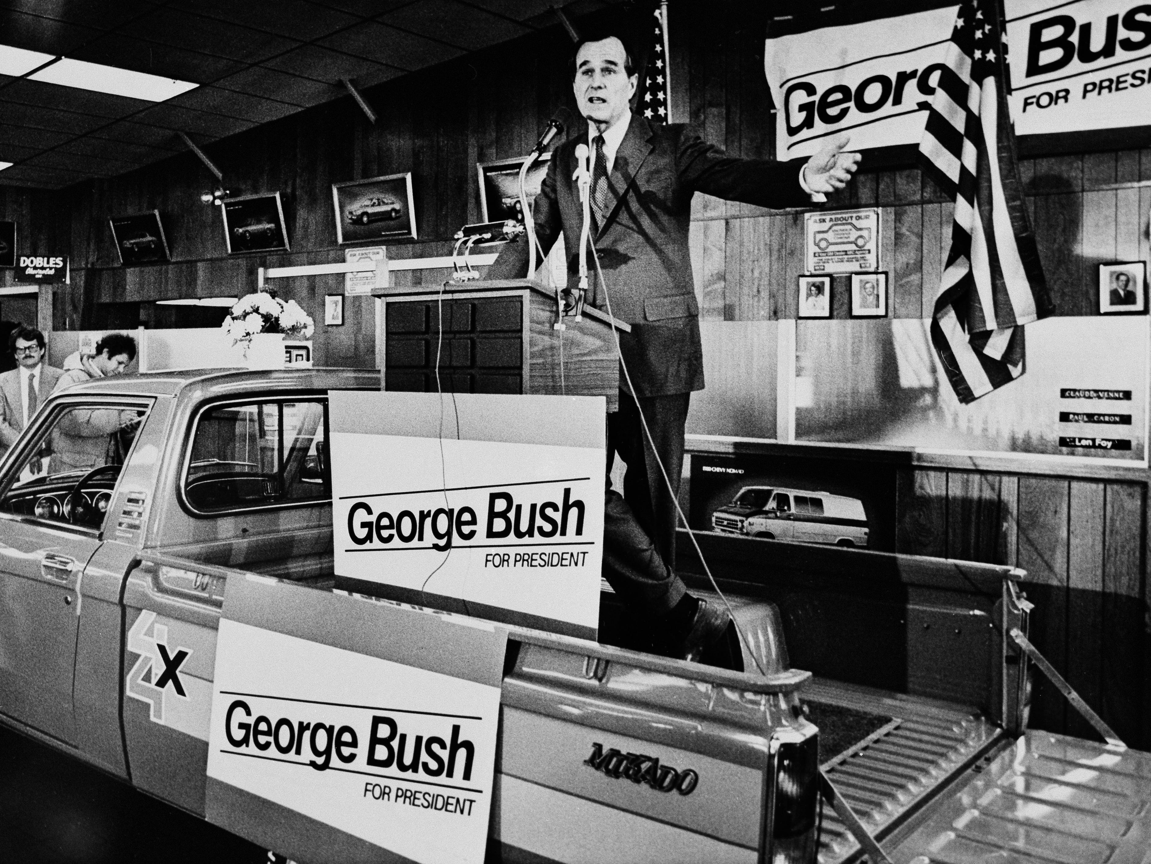 Presidential hopeful George Bush takes his New Hampshire campaign to a new car dealer in Manchester, N.H., Feb. 18, 1980, where the soapbox gave way to a pick-up truck for a speaking platform. Bush said he is riding high after Sunday's victory in the Puerto Rico primary, but still doesn't consider himself the frontrunner in the Republican race for the White House. (AP Photo/Tim Savard)