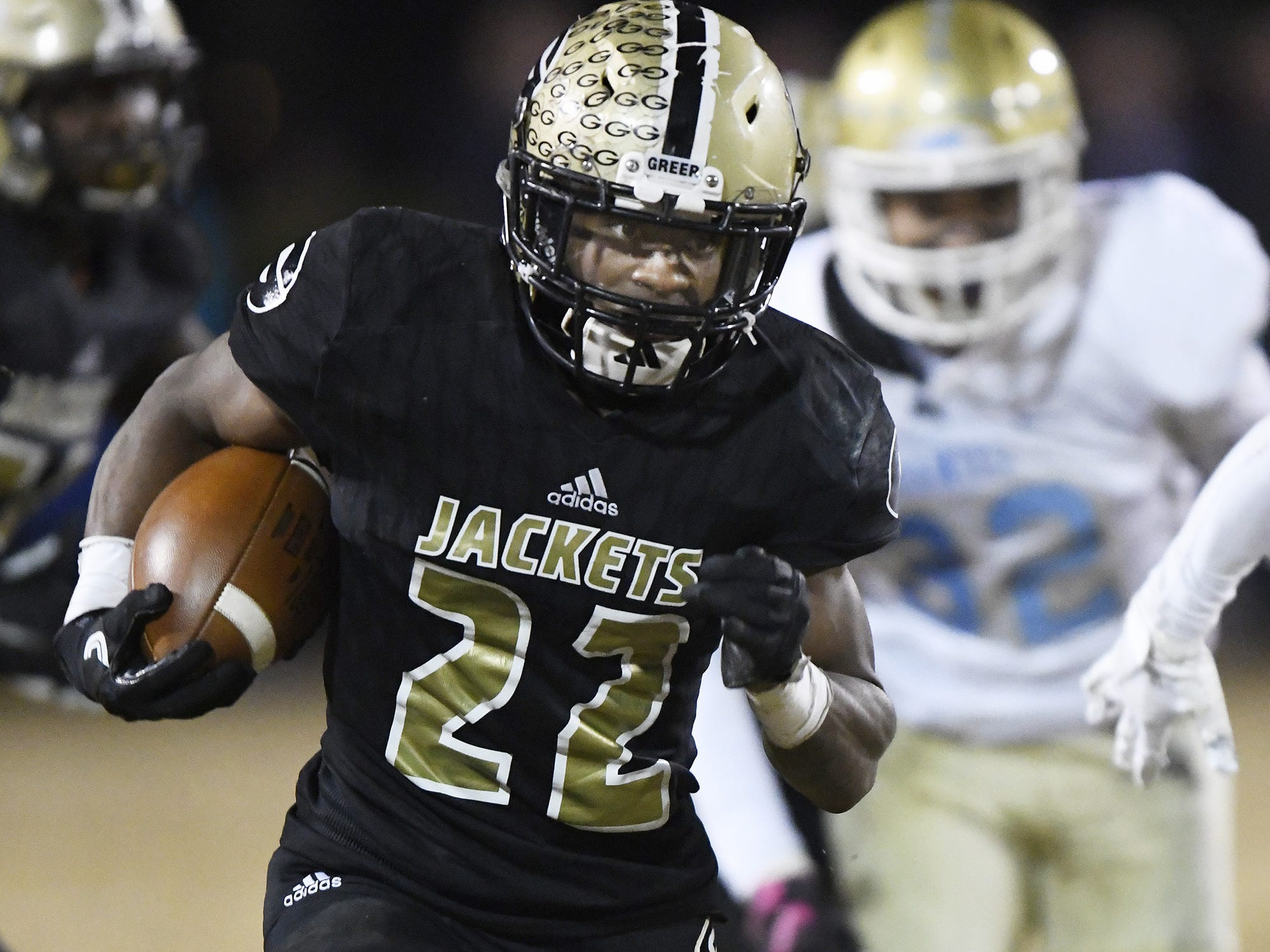 Greer's Dre Williams (22) takes off on one of his three touchdown runs against Daniel in the Class AAAA Upper State final Friday night.
