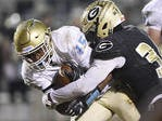 Greer's McZavion Holley, right, brings down Daniel's Billy Bruce during the Yellow Jackets' 35-23 victory Friday night.