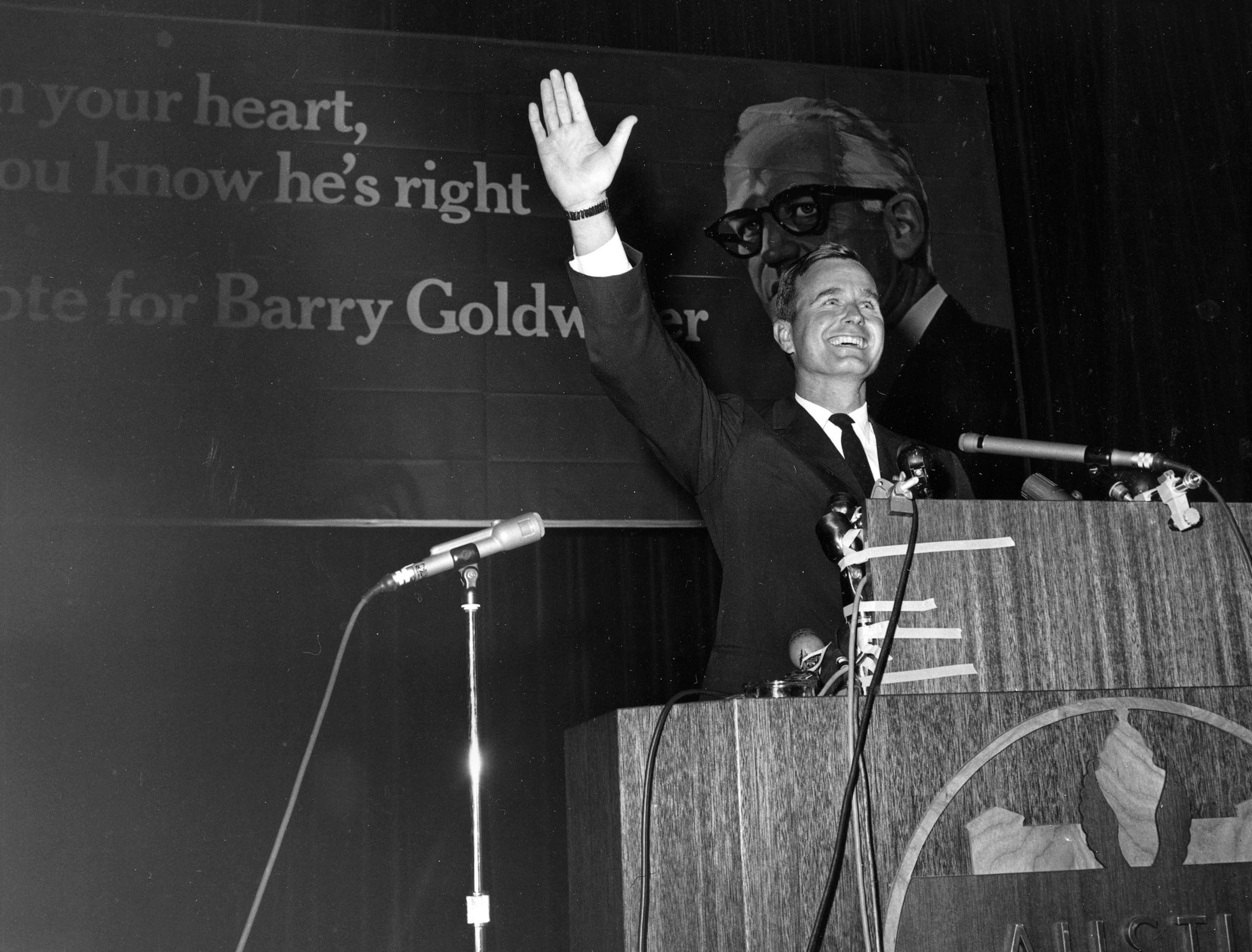 George Bush of Houston, Republican candidate for the U.S. Senate, waves to backers who cheer him after he addressed the Republican State Convention in Austin, Texas, Sept. 15, 1964.  Bush seeks the seat held by Sen. Ralph Yarborough.  (AP Photo)