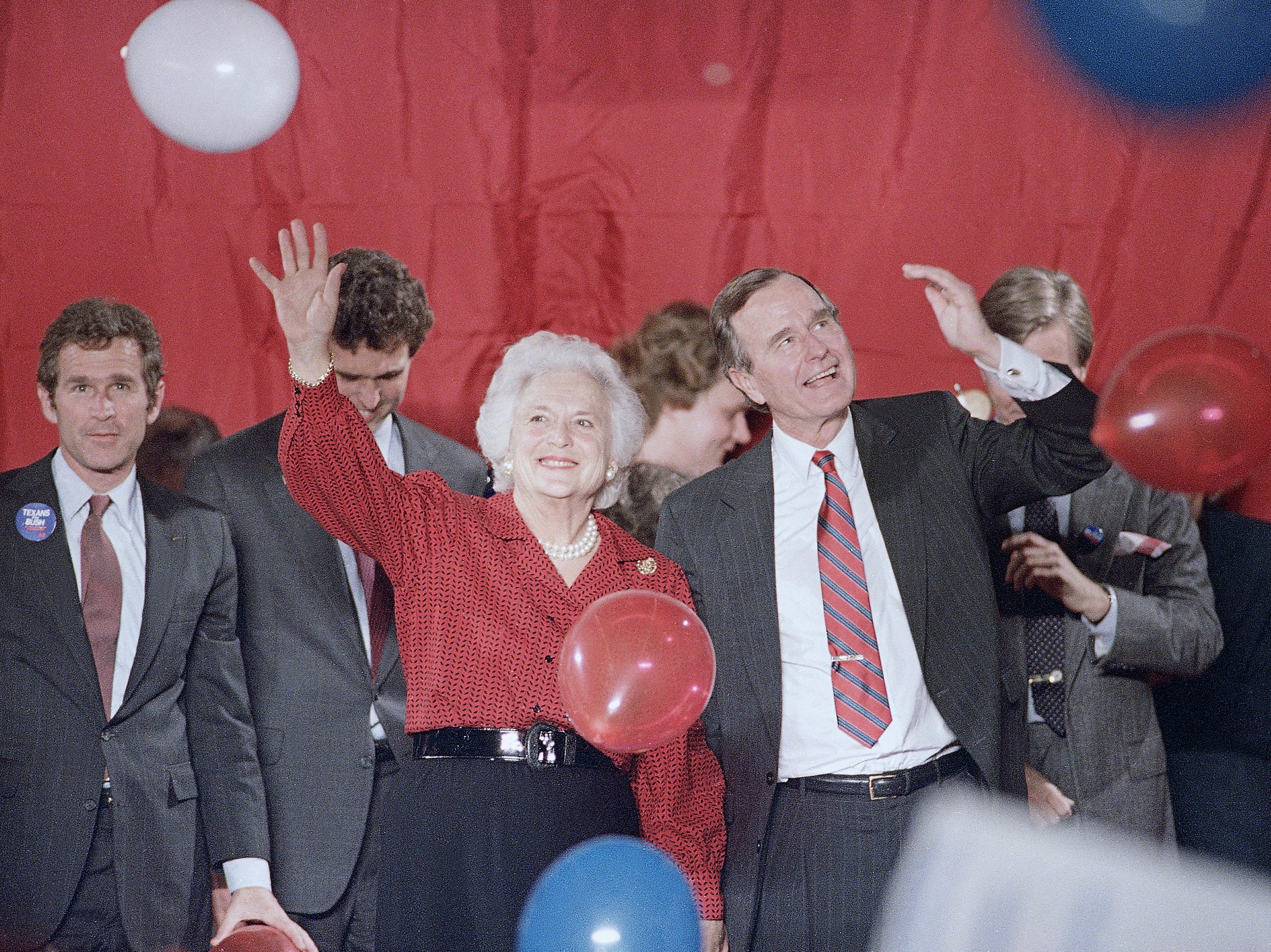 Vice President George H. Bush and Barbara Bush wave as balloons are dropped during a welcome rally in Houston, Nov. 8, 1988.  Bush will watch the election results in Houston on Tuesday. (AP Photo/John Duricka)