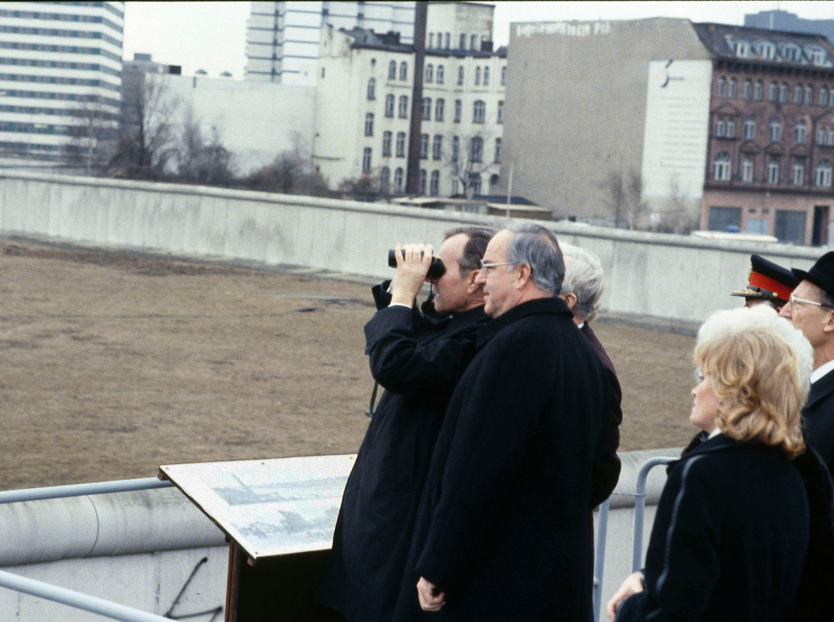 U.S. Vice President George Bush peers through binoculars as he has a look over the Berlin Wall into East Berlin from a stand at West Berlin's Potsdamerplatz, Feb. 1, 1983. Bush is flanked by Berlin Mayor Richard von Weizsaecker, left, and Chancellor Helmut Kohl. The wall is at right.  (AP Photo/Edwin Reichert)