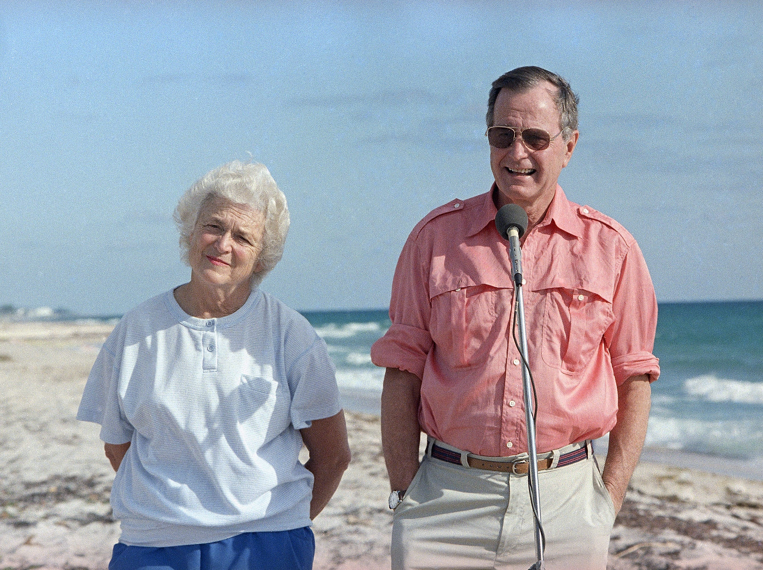 President-elect George Bush and his wife Barbara are shown during a morning beachfront news conference in Gulf Stream, Fla., Nov. 14, 1988. Bush is expected to return to Washington Tuesday after a long weekend vacationing in Florida. (AP Photo/Kathy Willens)