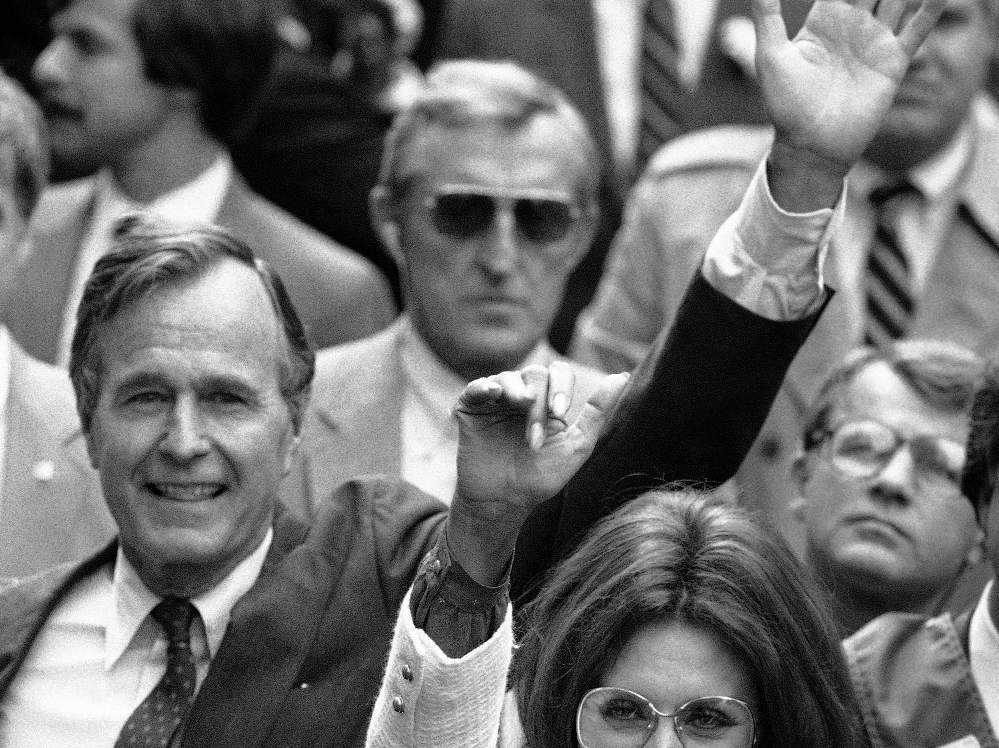 Vice President George Bush follows New York Columbus Day parade's Grand Marshall, actress Sophia Loren down New York's Fifth Avenue, Monday, Oct. 9, 1984 during parade festivities. (AP Photo/Thumma)
