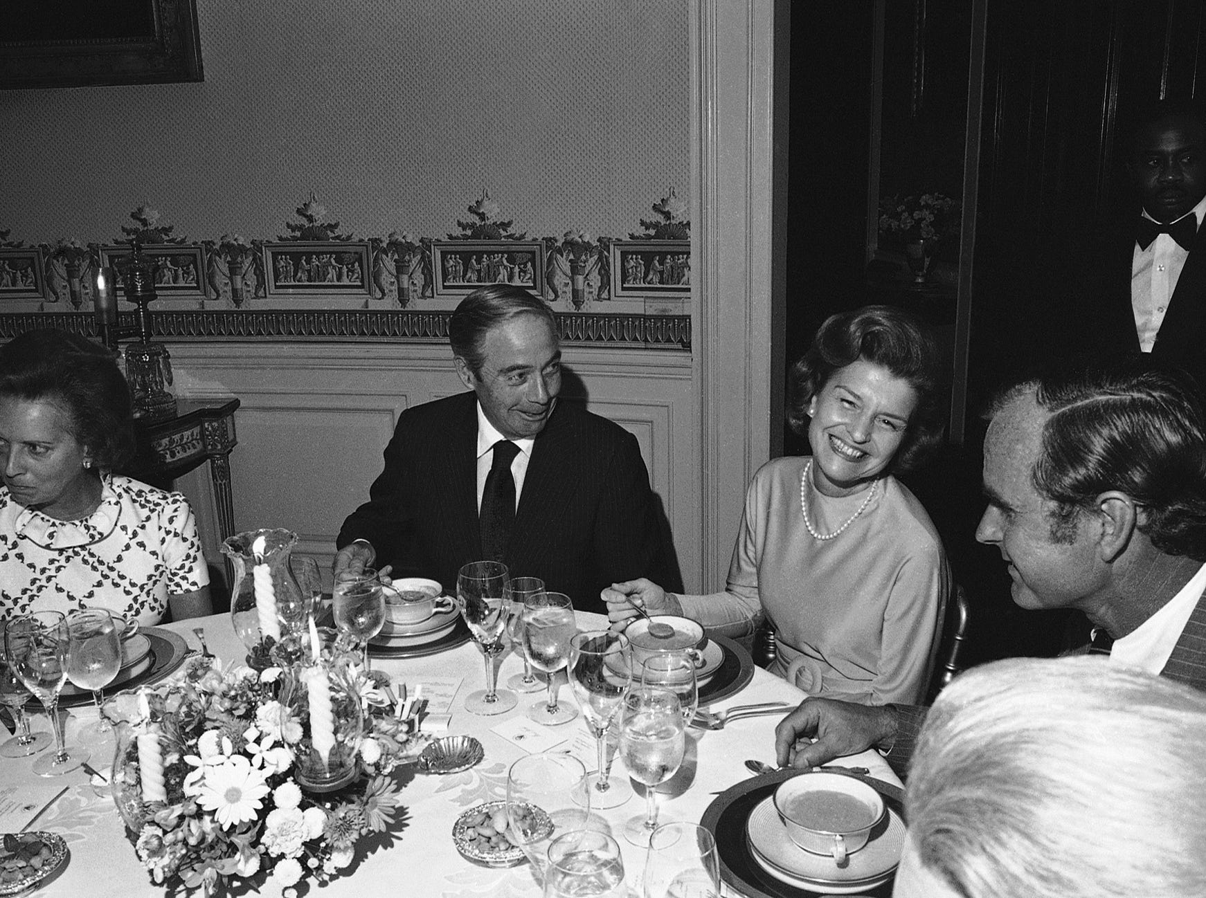 Former Pennsylvania Gov. William Scranton, left, chats with first lady Betty Ford and Republican National Committee Chairman George H.W. Bush during a White House dinner in Washington on Wednesday, Aug. 28, 1974. (AP Photo)
