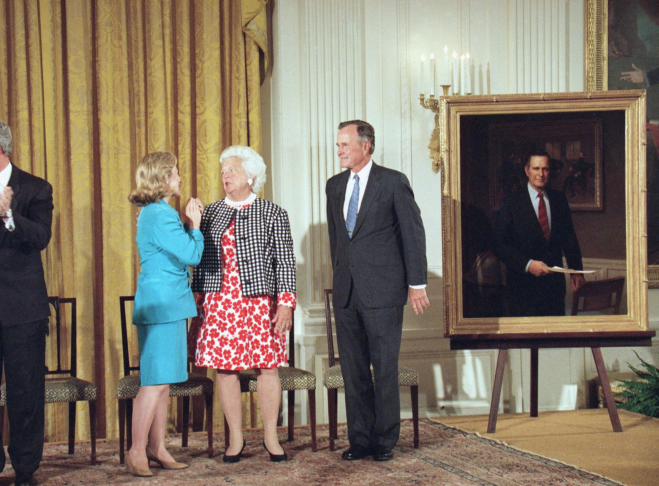 President Bill Clinton, left, and first lady Hillary Rodham Clinton, second from left, applaud former President George H.W. Bush, right, and his wife Barbara, after the Bushes official formal White House portrait was unveiled, in the East Room of the White House in Washington, Monday, July 17, 1995. Both the Bushes portraits, done by Herbert Abrams of Warren, Conn., were unveiled Monday. (AP Photo/Wilfredo Lee)