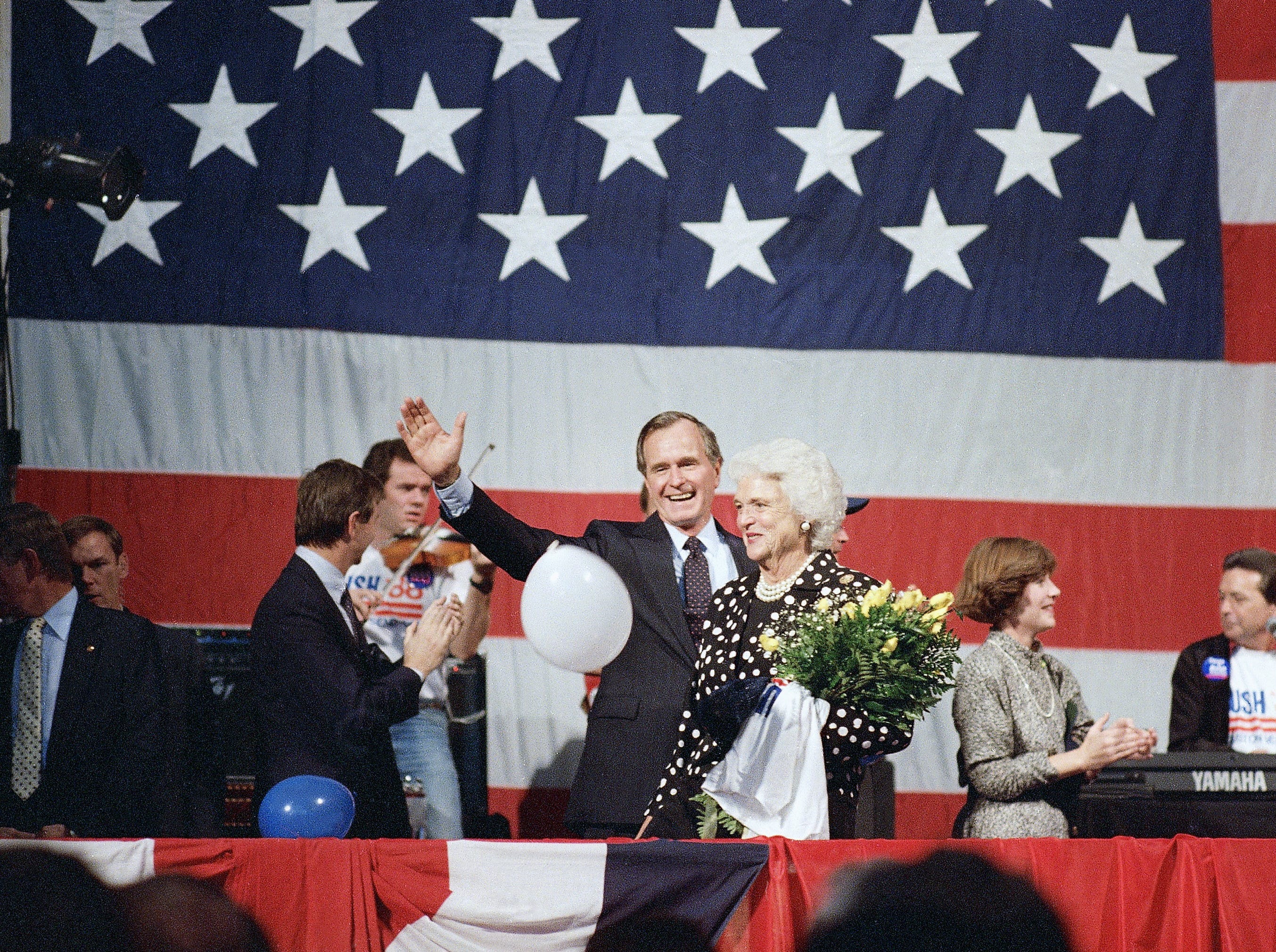 Vice President George H. Bush and wife, Barbara, backed up by their family, meet supporters, Oct. 12, 1987, in Houston where Bush announced that he was a candidate for nomination by the Republican Party for president of the United States. (AP Photo/Ed Kolenovsky)