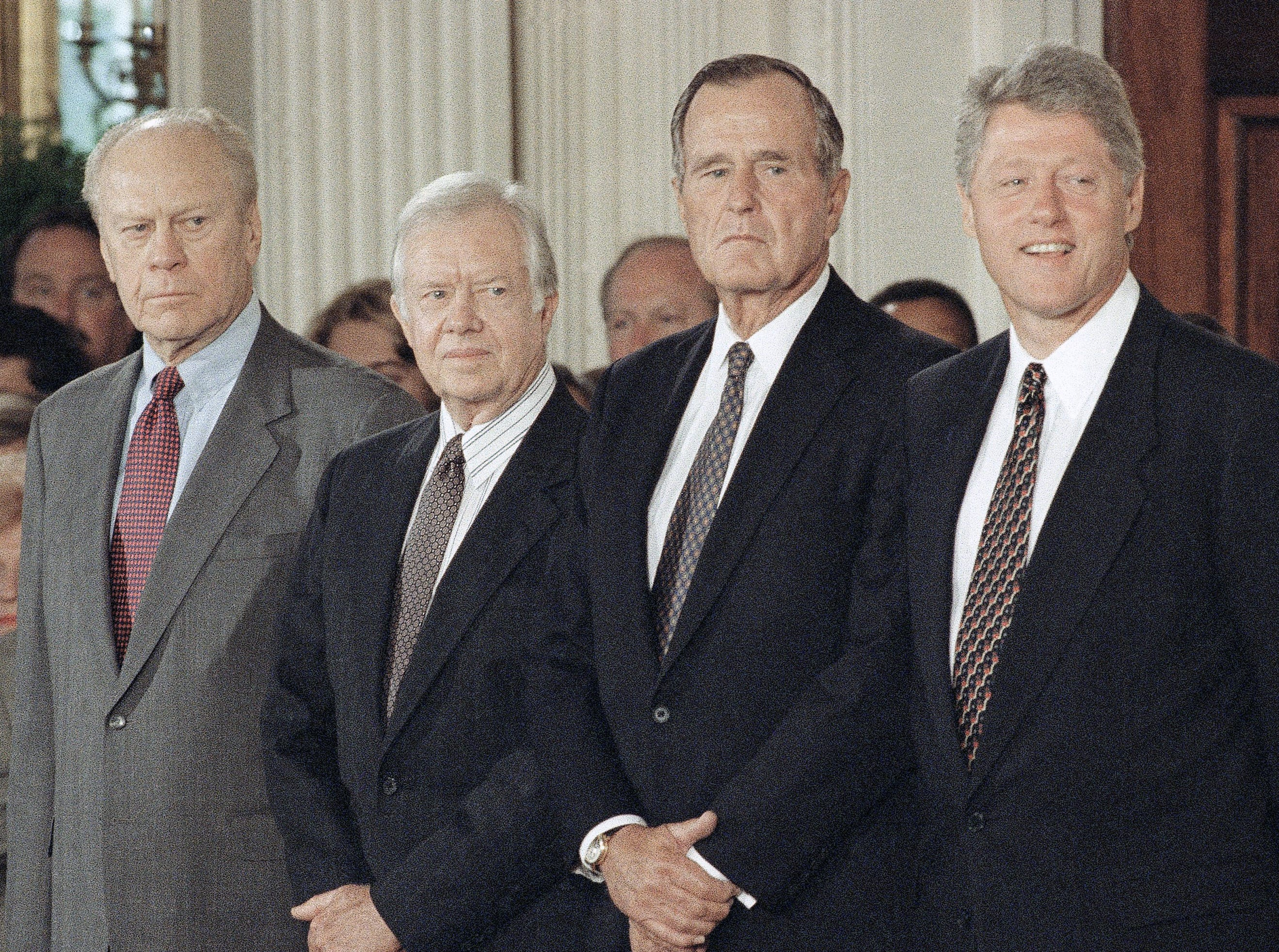 From left Gerald Ford, Jimmy Carter, George H.W. Bush and Bill Clinton pose for photographers during the signing ceremony for the North American Free Trade Agreement in Washington  Sept. 14, 1993. (AP Photo/Wilfredo Lee)