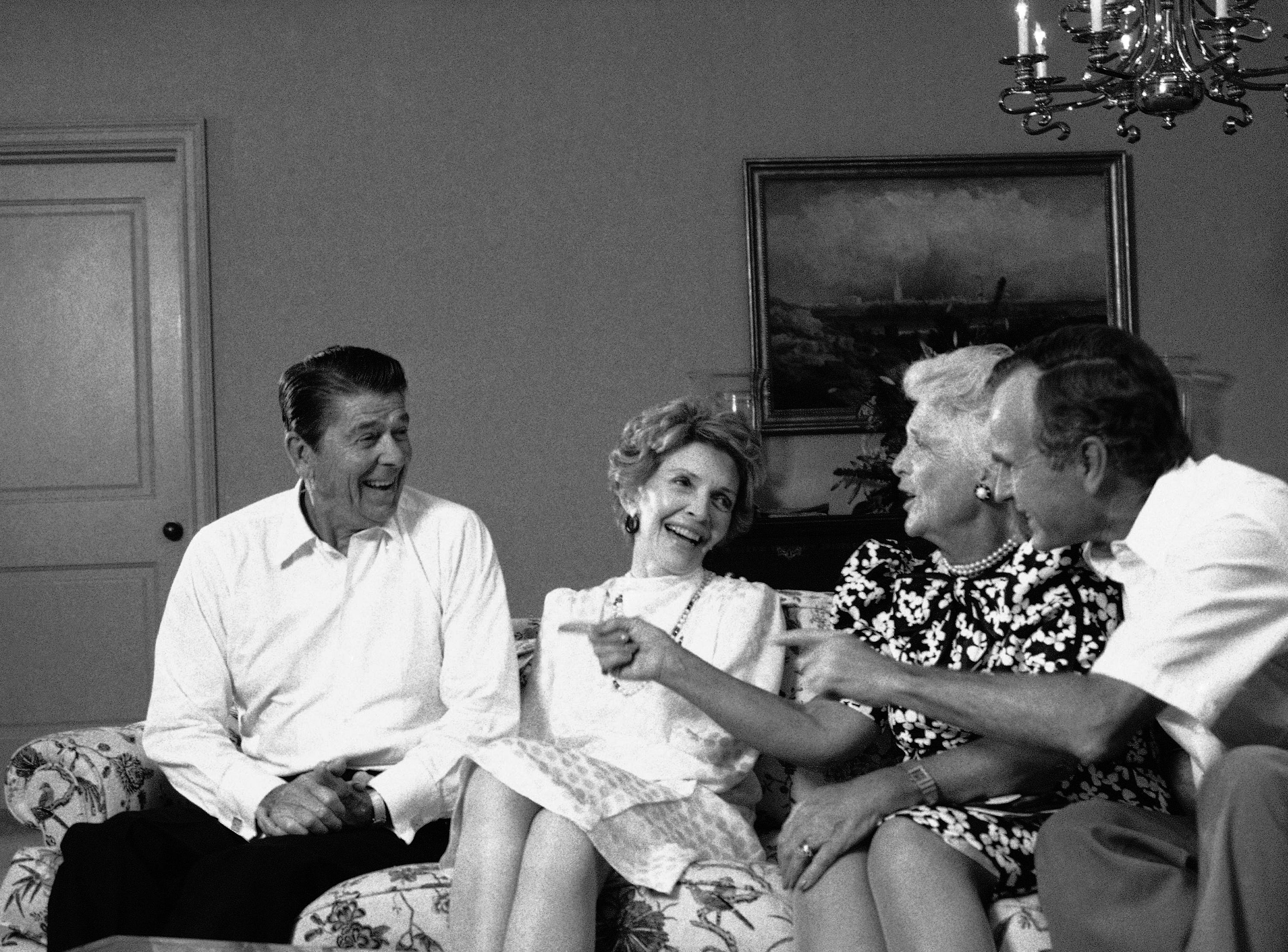 President Reagan shares a laugh with first lady Nancy Reagan and Vice President and Mrs. George Bush at night on Wednesday, August 22, 1984 in Dallas after the Republican National Convention nominated him for a second term. (AP Photo/J. Scott Applewhite)