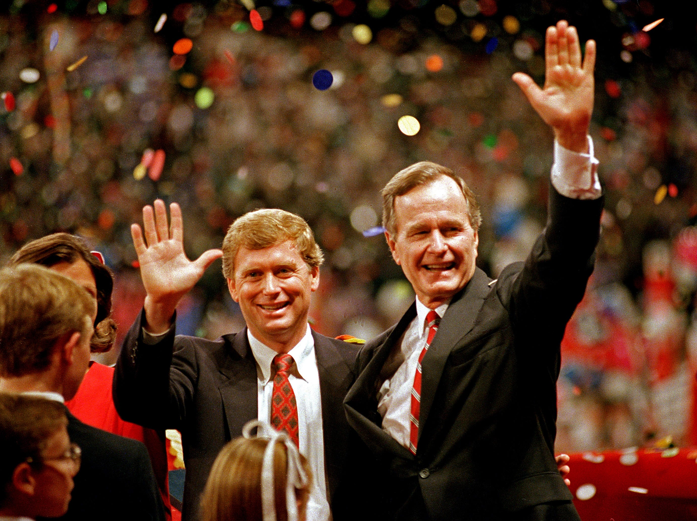 ** ADVANCE FOR SUNDAY, SEPT. 28 AND THEREAFTER -- FILE ** In this Aug. 18, 1988 file photo, Republican presidential candidate, Vice President George Bush , right,and his running mate Sen. Dan Quayle, R-Ind., wave to the assembly of the Republican National Convention in New Orleans  after their respective acceptance speeches for the presidential and vice-presidential nomination. (AP Photo/J. Scott Applewhite, File)