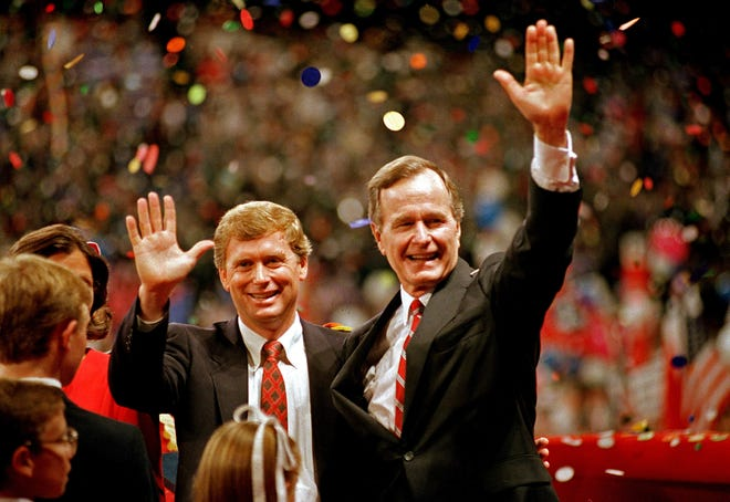 In this Aug. 18, 1988 file photo, Republican presidential candidate, Vice President George Bush, right, and his running mate Sen. Dan Quayle, R-Ind., wave to the assembly of the Republican National Convention in New Orleans after their respective acceptance speeches.