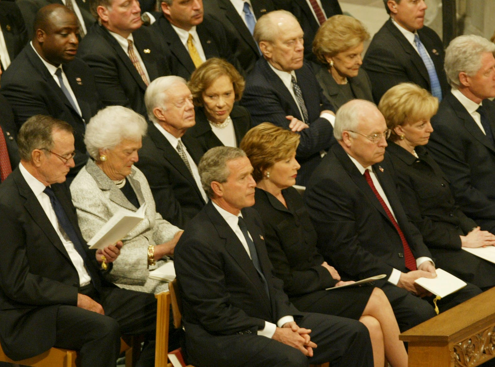 President Bush, front center, and first lady Laura Bush sit with former US Presidents and their wives during during funeral services at the National Cathedral in Washington Friday, June 11, 2004 for former President Ronald Reagan. Back row, from left are: George H.W. and Barbara Bush, Jimmy and Rossalyn Carter, Gerald and Betty Ford. Front row, from left are: George and Laura Bush, Vice President Dick Cheney and wife Lynne, and Bill Clinton and Sen. Hillary Clinton, D-N.Y. (AP Photo/Ron Edmonds)