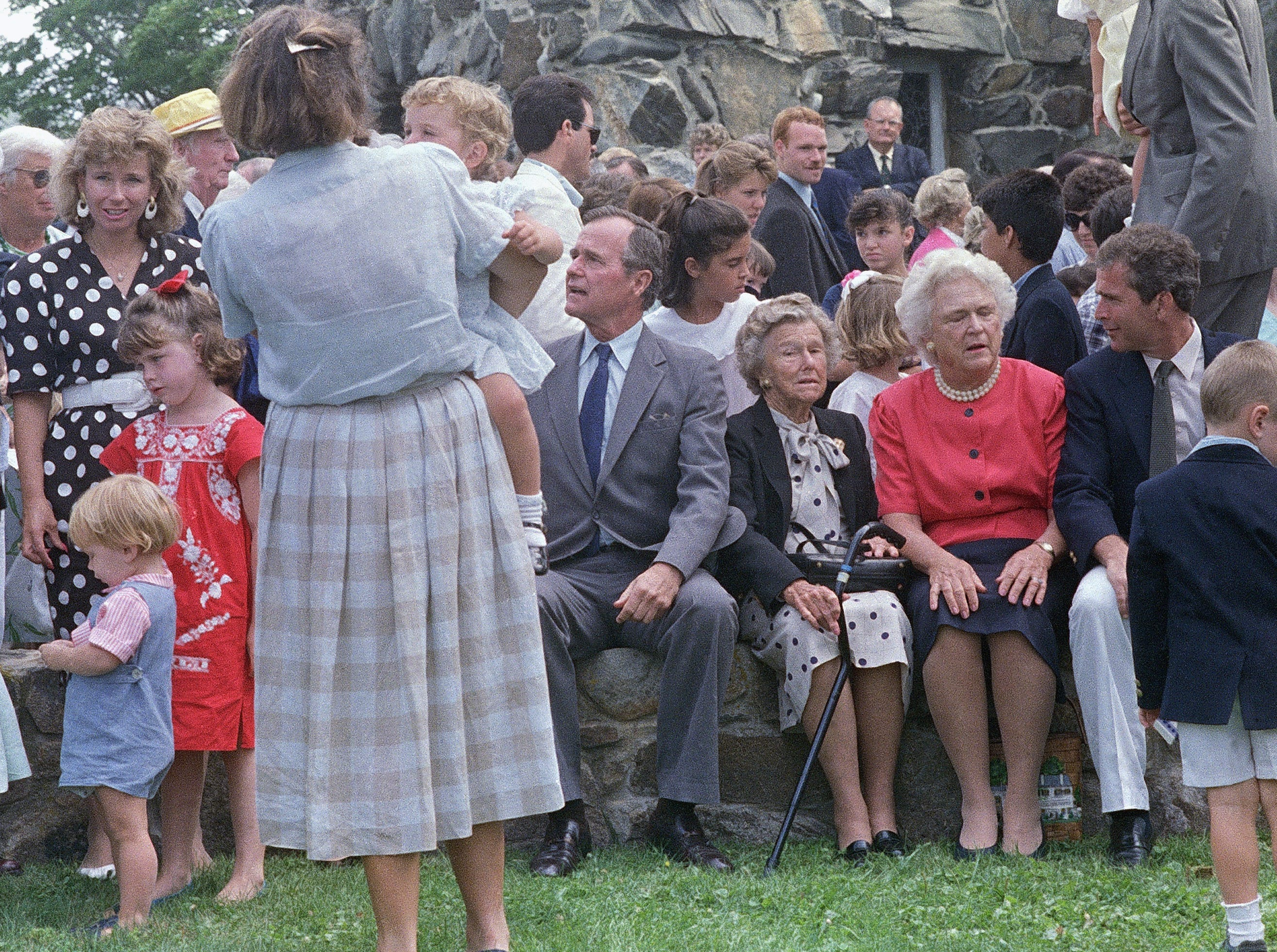 Vice President George H. W. Bush, left, poses with his family outside St. Anns Church, Aug. 8, 1988, Kennebunkport, Me. Sitting next to Bush is his mother, Dorothy Bush, wife, Barbara Bush, second from right, and son George W. Bush. (AP Photo/Herb Swanson)