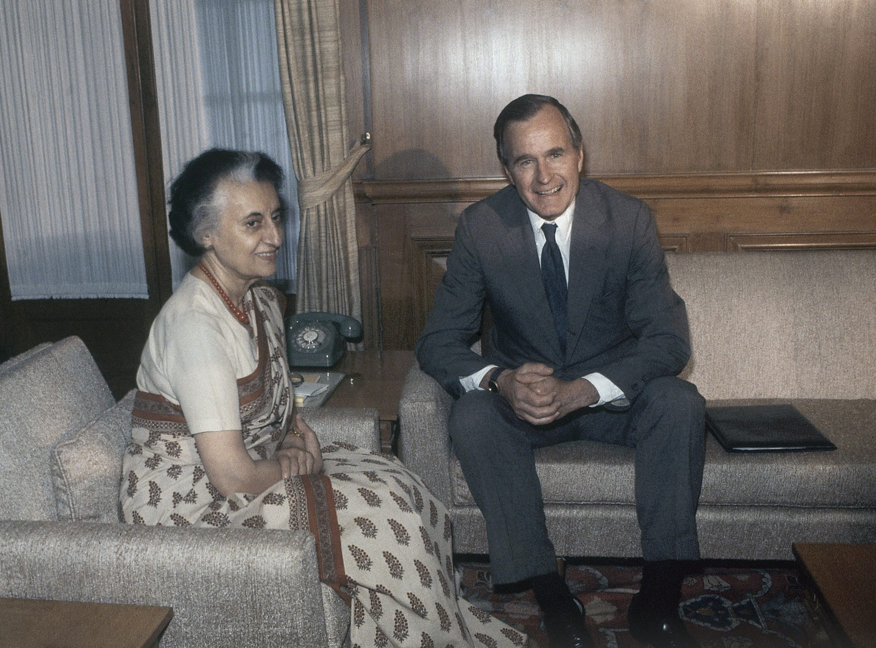 U.S. Vice President George H. W. Bush, right, and Prime Minister Indira Gandhi are shown discussing the international situation and bilateral affairs, Monday, May 14, 1984, New Delhi, India. (AP Photo/Sondeep Shankar)