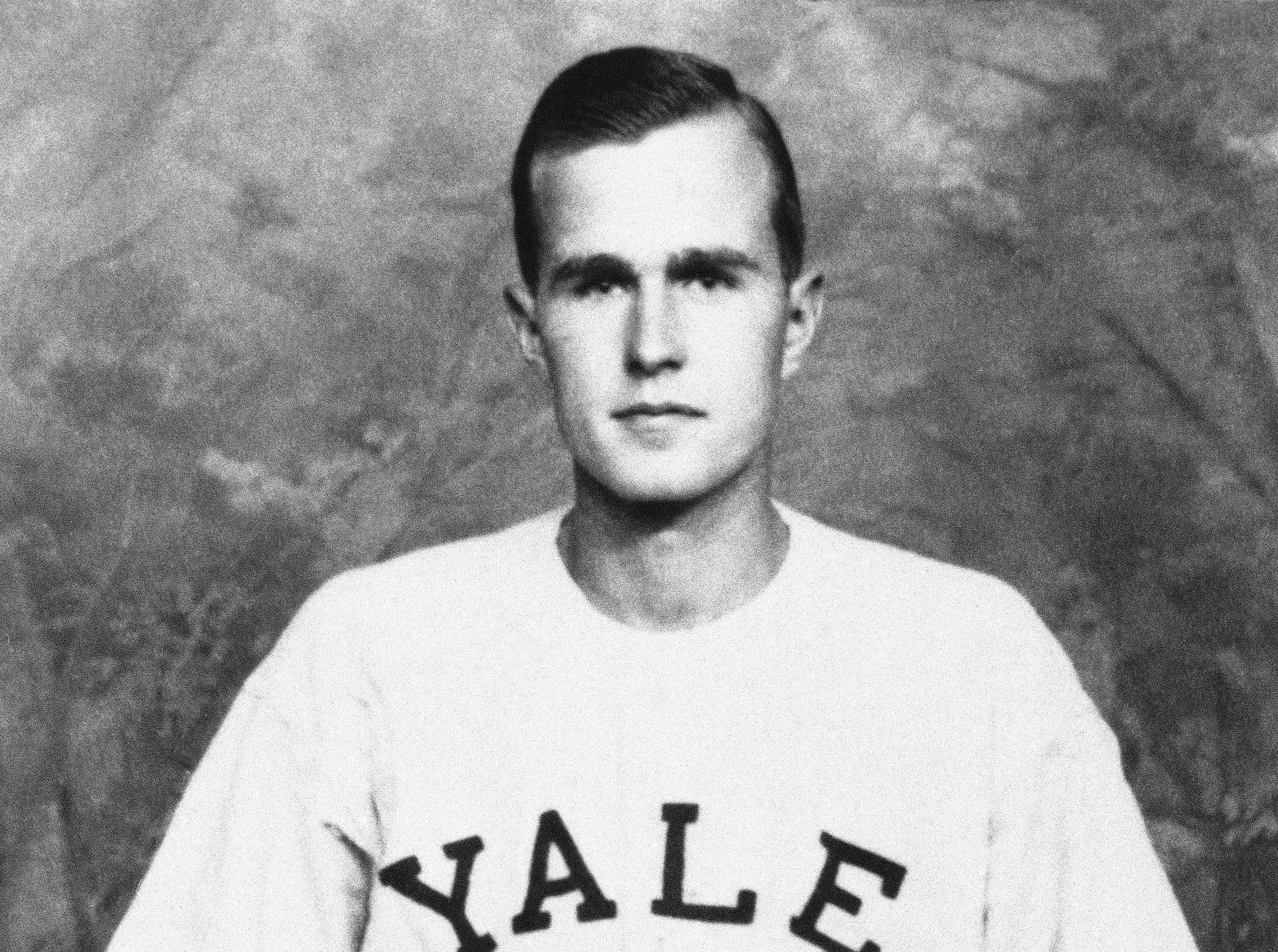 FILE - In this 1947 photo, George H.W. Bush is shown as captain of the Yale baseball team, in New Haven, Conn. Bush played in the first-ever College World Series in 1947. (Bush died Nov. 30, 2018, at the age of 94. Bush was largely known for his work in public office, from his time as a Texas congressman and CIA director to his years in the White House as president and Ronald Reagan's vice president. But the World War II hero and great-grandfather also was an avid skydiver, played in the first-ever College World Series and was the longest-married president in U.S. history.AP Photo/File)