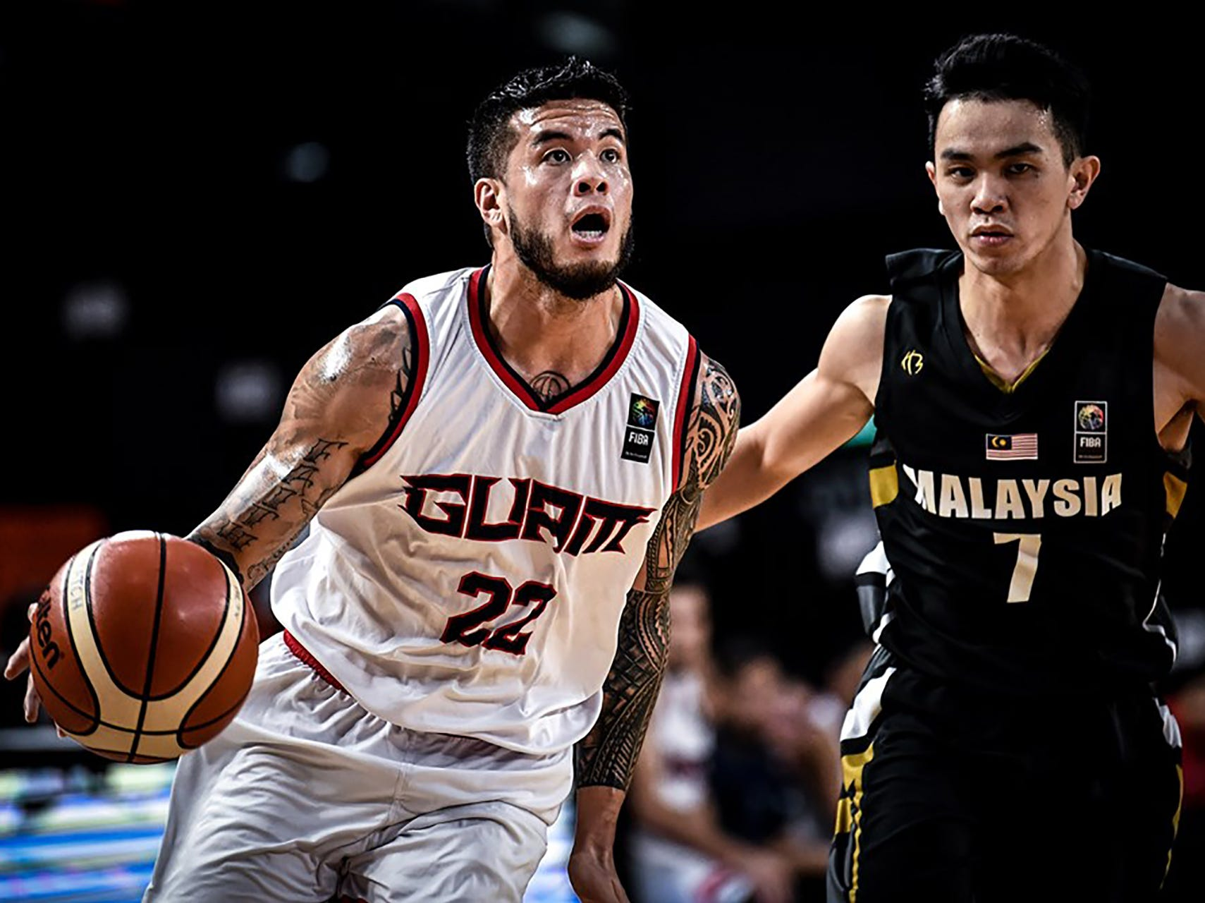 Daren Hechanova gets ready to dish one of his 11 assists during his team's final game against Malaysia. Hechanova had a triple double, and Guam won 101-78 to complete a 6-0 sweep of all teams in  Asia's Eastern Division and move on to the qualifier round of the FIBA Asia Cup 2021.