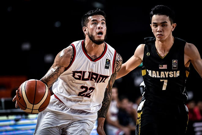 In this file photo from Dece.ber 2018, Team Guam guard Daren Hechanova gets ready to dish one of his 11 assists during the team's final game against Malaysia. Hechanova had a triple double, and Guam won 101-78 to complete a 6-0 sweep of all teams in Asia's Eastern Division and move on to the qualifier round of the FIBA Asia Cup 2021.