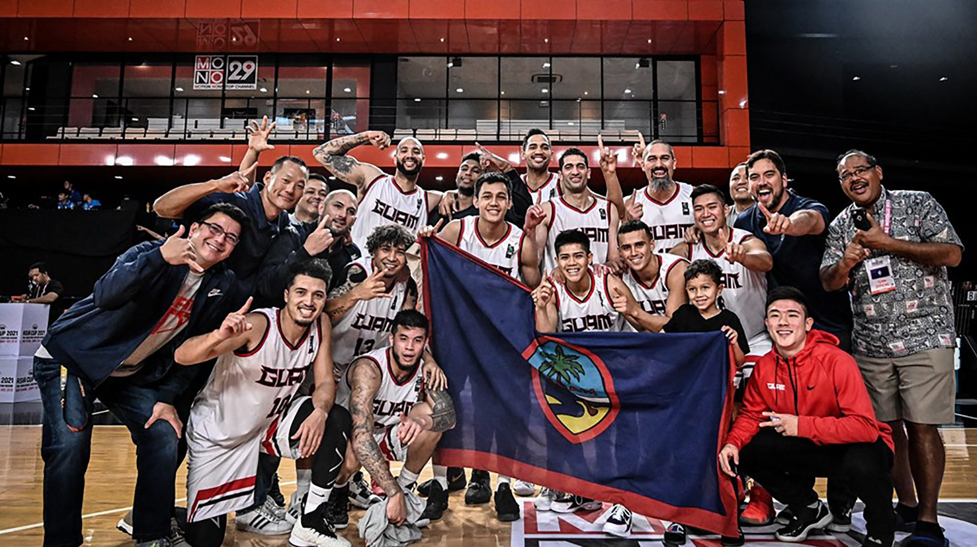 Team Guam hoists the island icon before the final game against Malaysia. Guam won 101-78 to complete a 6-0 sweep of all teams in  Asia's Eastern Division and move on to the qualifier round of the FIBA Asia Cup 2021