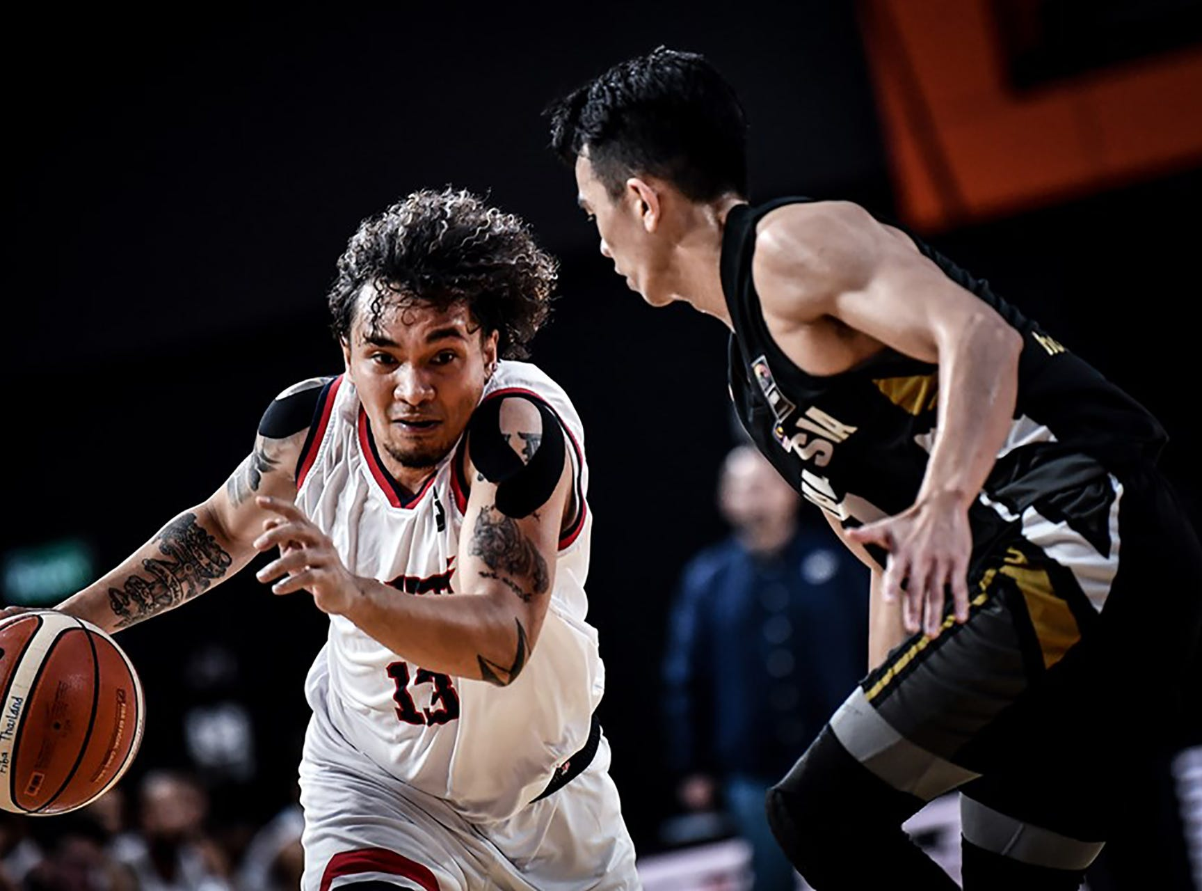 JP Cruz drives around a defender during his team's final game against Malaysia. Cruz missed just one shot in six attempts, made three of four treys, and hit all four of his free throws for 16 points. Guam won 101-78 to complete a 6-0 sweep of all teams in  Asia's Eastern Division and move on to the qualifier round of the FIBA Asia Cup 2021.
