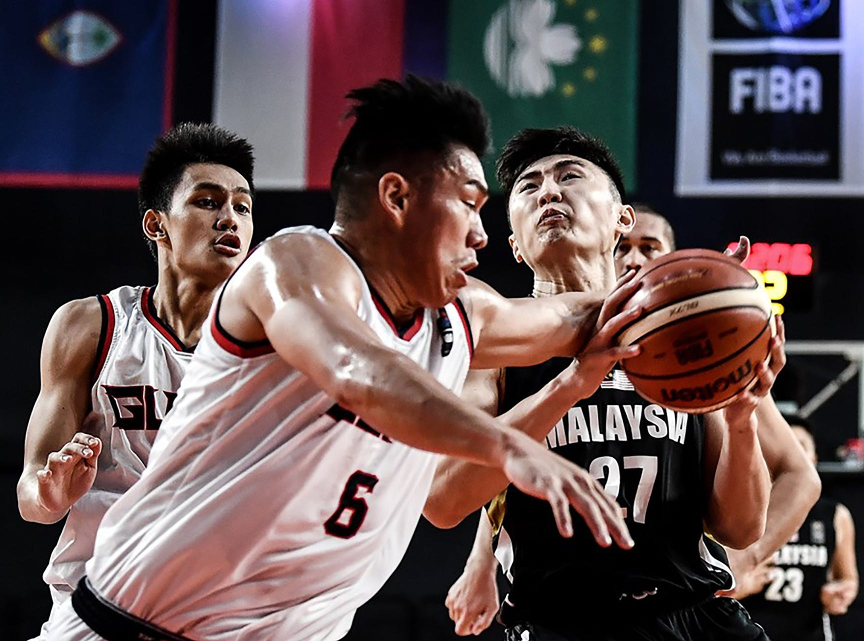 Earvin Jose prevents a Malay layup during his team's final game against Malaysia. Guam won 101-78 to complete a 6-0 sweep of all teams in  Asia's Eastern Division and move on to the qualifier round of the FIBA Asia Cup 2021