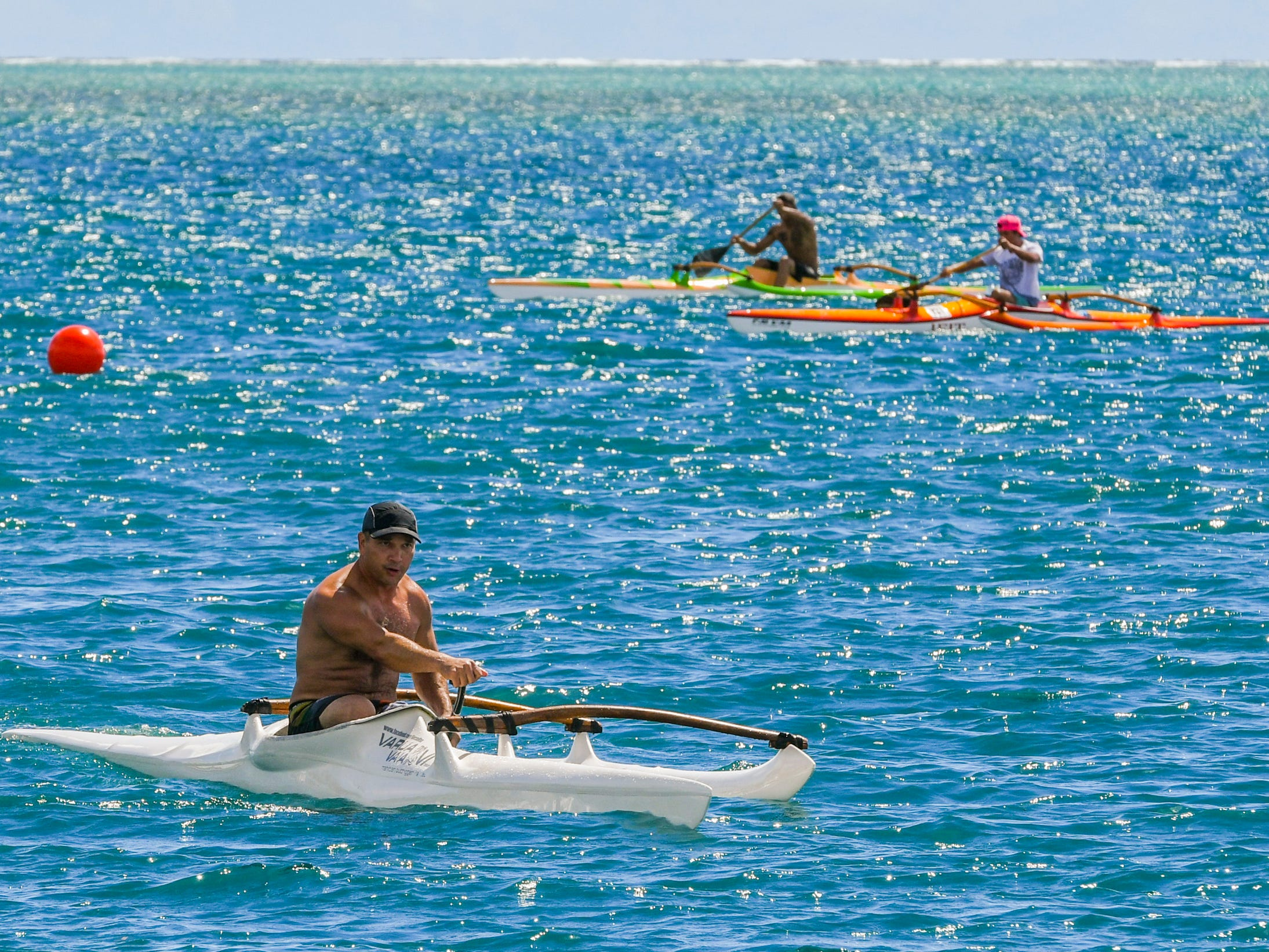 Paddler Sith Khamvongsa, front, enjoys a comfortable lead during his participation in a Rebellion division canoe race at the annual Malesso Fiestan Tasi on Saturday, Dec. 1, 2018 at the Malesso Veteran Sons & Daughters Pier Park. The village festival is slated to continue on Sunday, Dec. 2, with plans of a spearfishing competition, personal watercraft racing, live entertainment and an evening fireworks show being held.