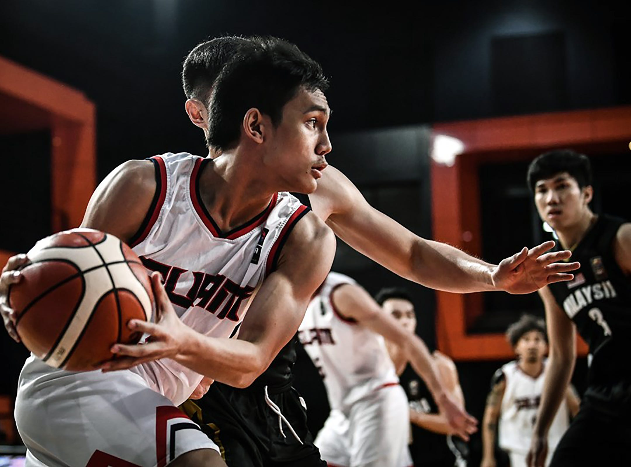 Guam's Chris Conner looks for an opening during his team's final game against Malaysia. Guam won 101-78 to complete a 6-0 sweep of all teams in  Asia's Eastern Division and move on to the qualifier round of the FIBA Asia Cup 2021
