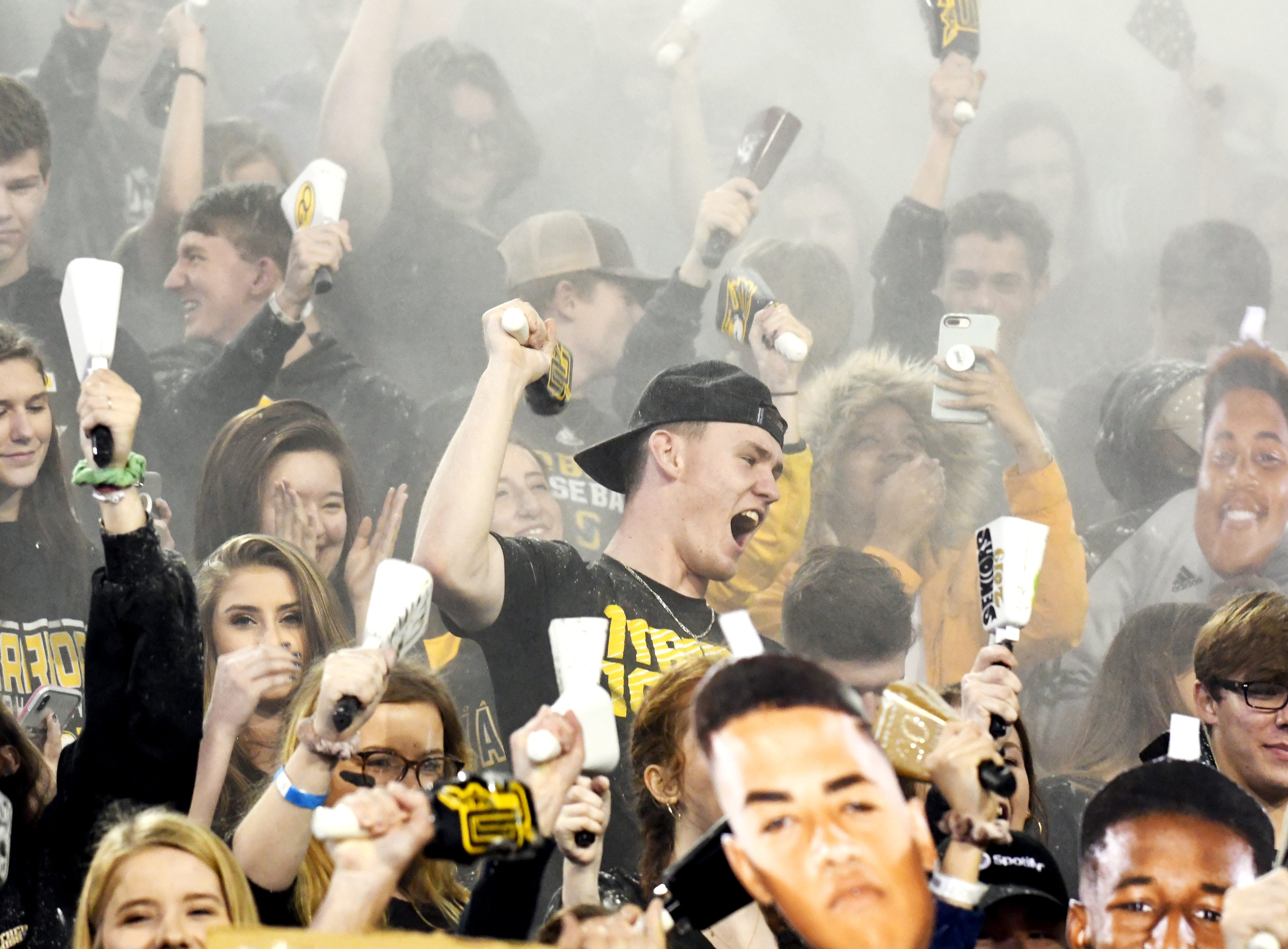 Oak Grove fans celebrate to start of the 6A state championship game against Horn Lake at M.M. Roberts Stadium in Hattiesburg on Friday, November 30, 2018.