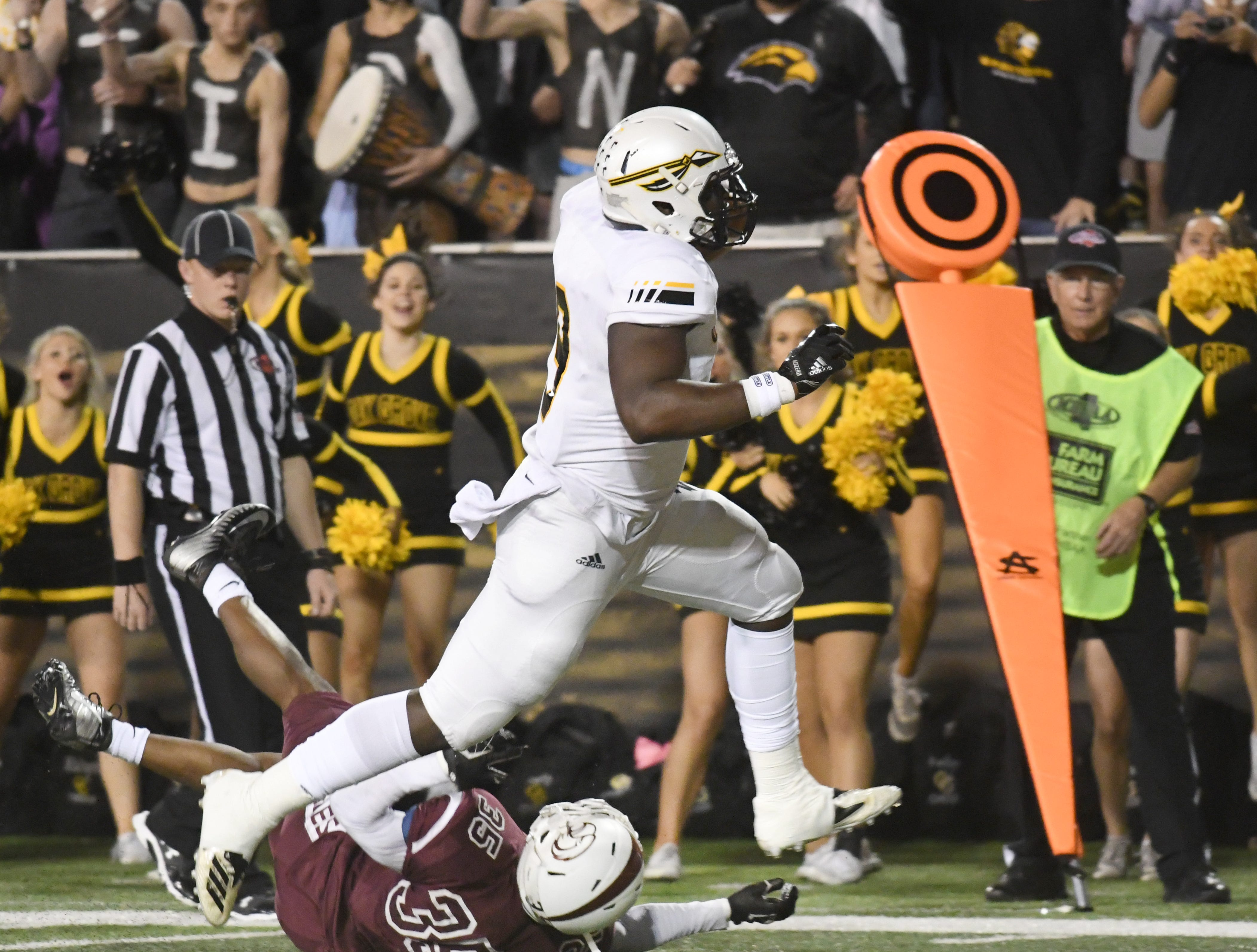 Oak Grove tight end 	Tyson Keys runs over a defender for a touchdown in the 6A state championship game against Horn Lake at M.M. Roberts Stadium in Hattiesburg on Friday, November 30, 2018.