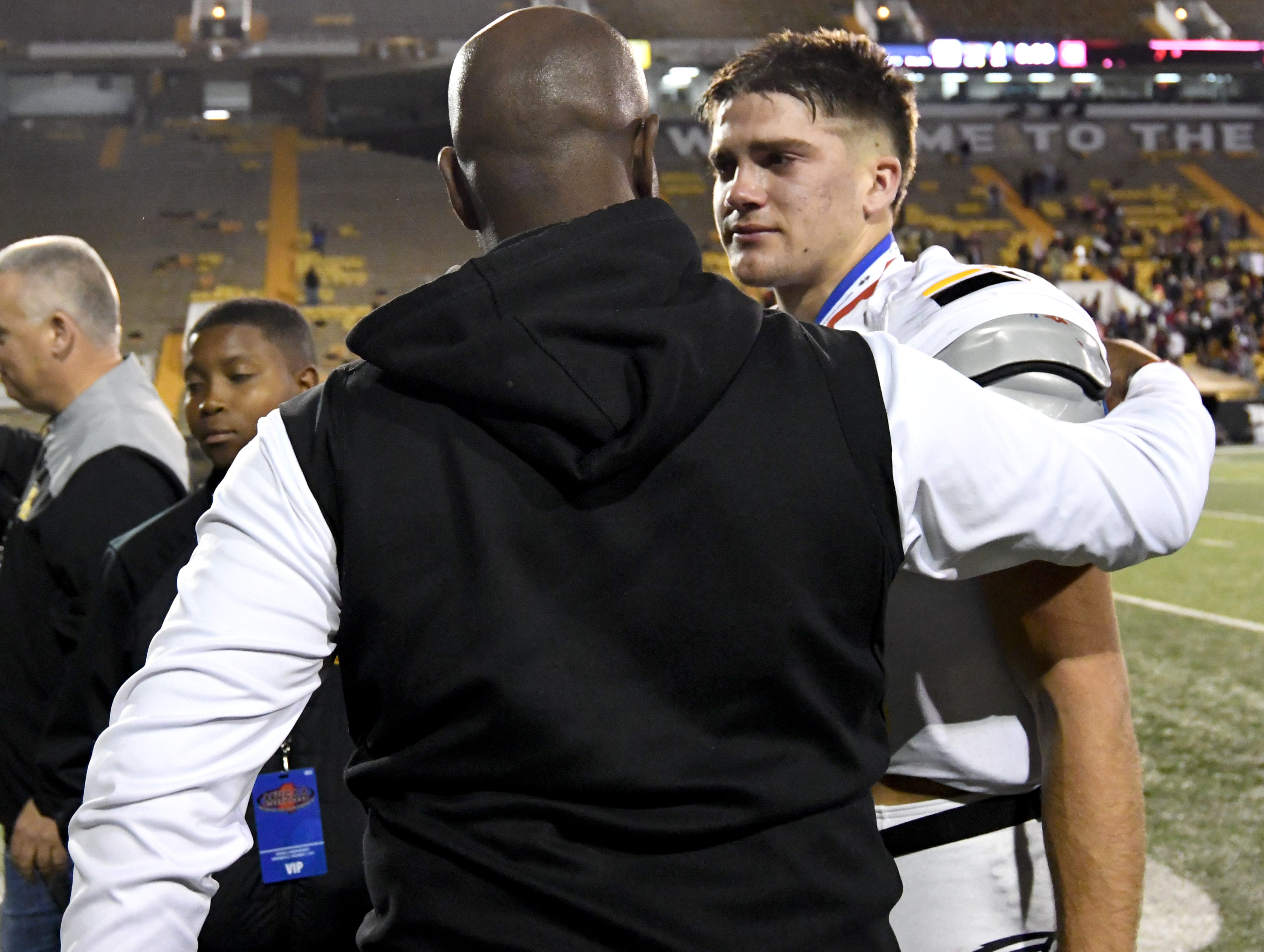Oak Grove quarterback John Rhys Plumlee is comforted by Hattiesburg head coach Tony Vance after losing to Horn Lake in the 6A state championship game at M.M. Roberts Stadium in Hattiesburg on Friday, November 30, 2018.