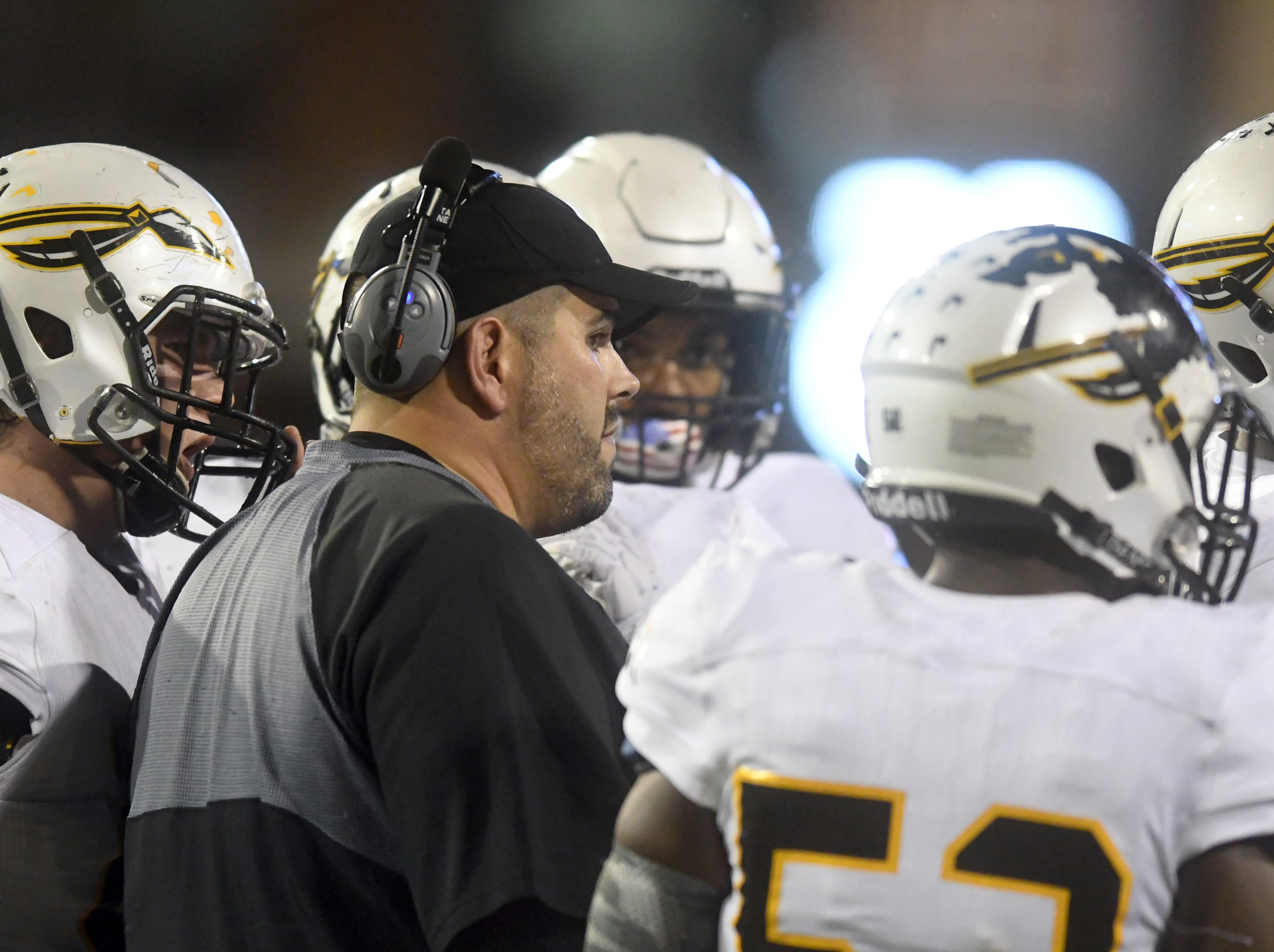 Oak Grove head coach  Drew Causey speaks with his players in the 6A state championship game against Horn Lake at M.M. Roberts Stadium in Hattiesburg on Friday, November 30, 2018.