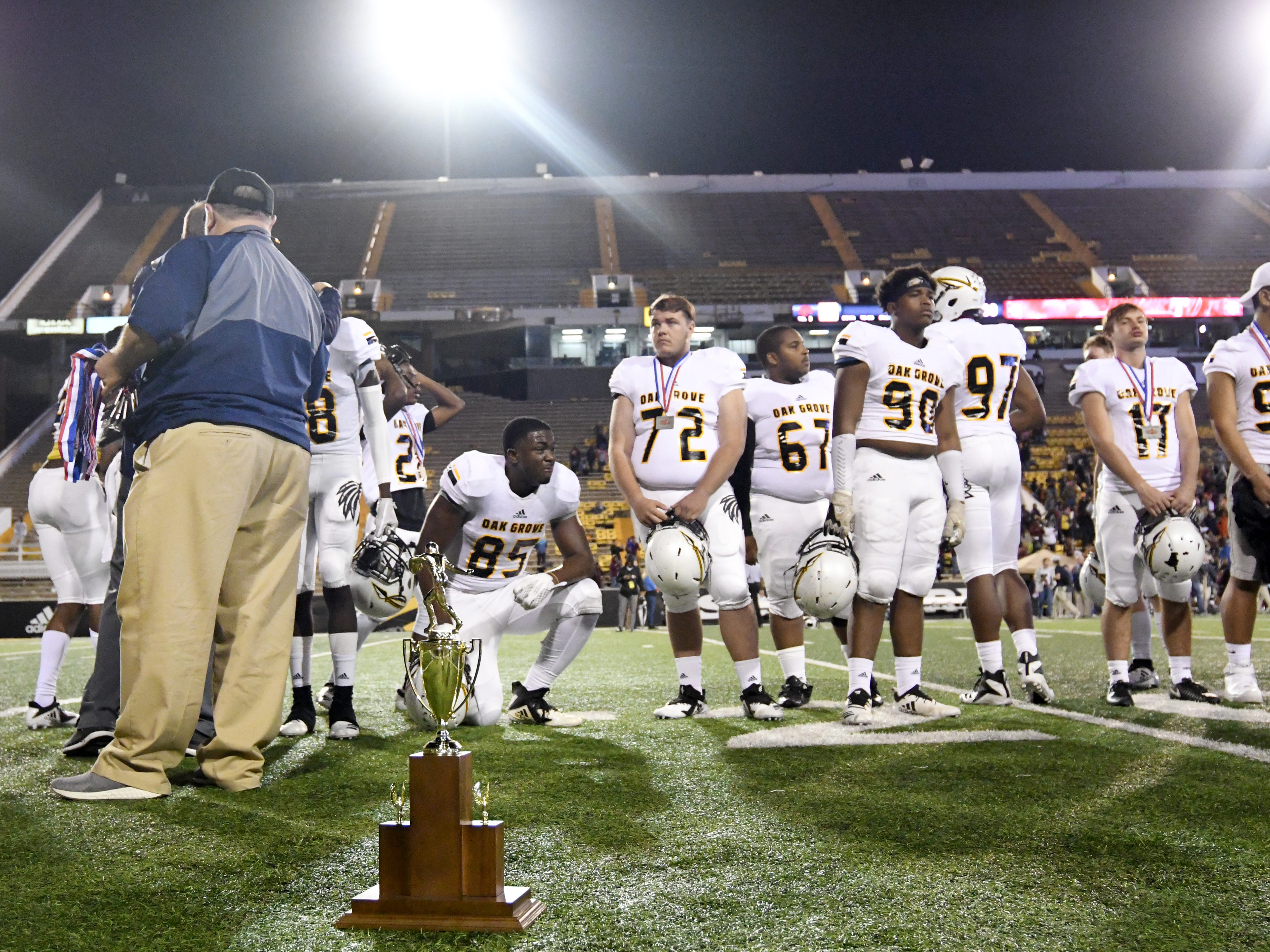Oak Grove players show emotion as they lose to Horn Lake in the 6A state championship game at M.M. Roberts Stadium in Hattiesburg on Friday, November 30, 2018.
