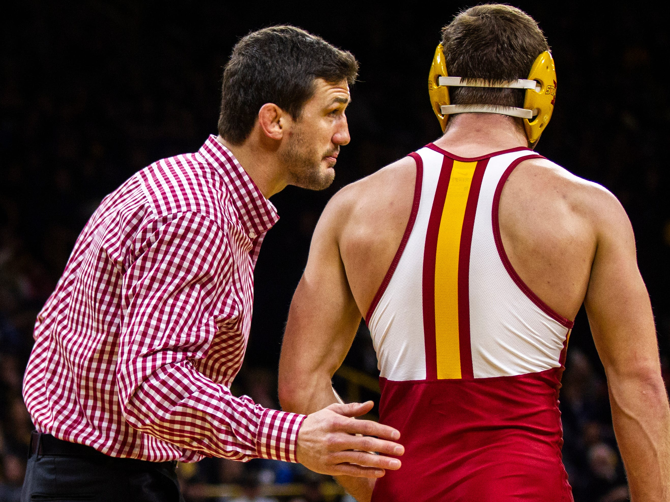 Iowa State assistant coach Derek St. John talks with Chase Straw during a NCAA Cy-Hawk series wrestling dual on Saturday, Dec. 1, 2018, at Carver-Hawkeye Arena in Iowa City.