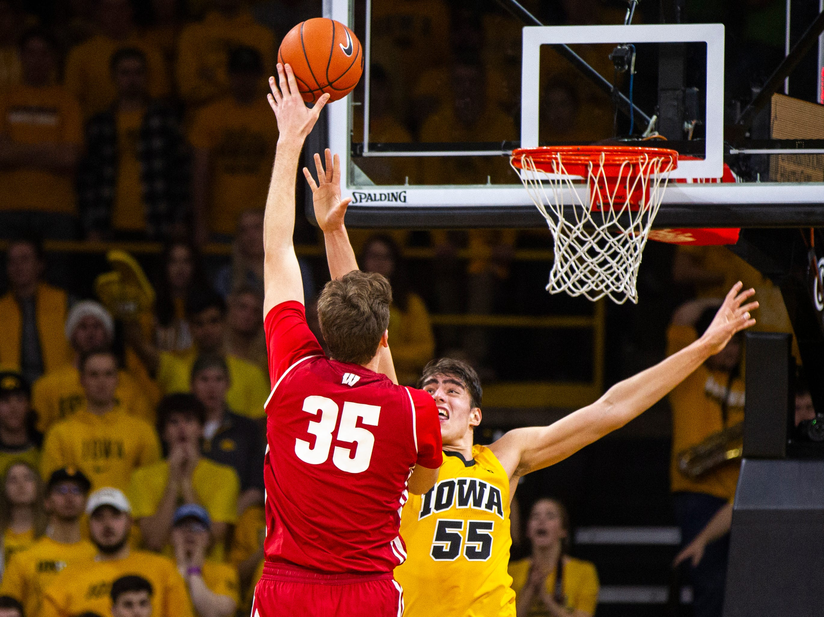 Wisconsin's Nate Reuvers (35) attempts a shot past Iowa forward Luka Garza (55) during a NCAA Big Ten Conference men's basketball game on Friday, Nov. 30, 2018, at Carver-Hawkeye Arena in Iowa City.
