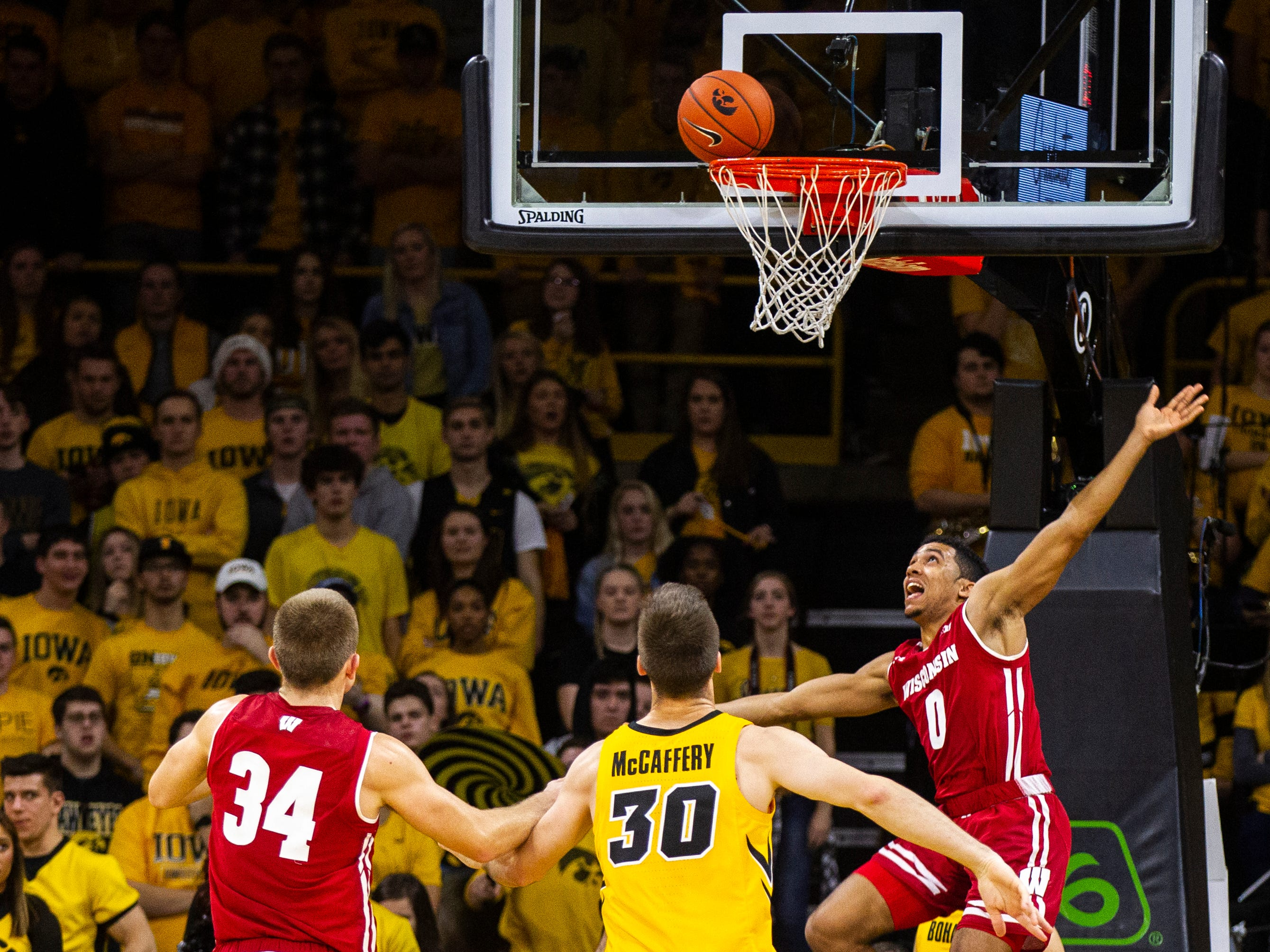 Wisconsin's D'Mitrik Trice (0) misses a basket during a NCAA Big Ten Conference men's basketball game on Friday, Nov. 30, 2018, at Carver-Hawkeye Arena in Iowa City.