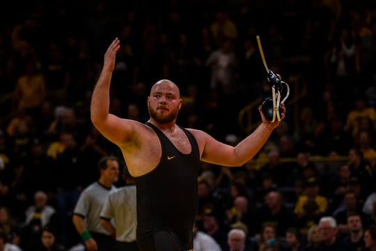 Iowa's Sam Stoll pumps up the crowd after his match at 285 during a NCAA Cy-Hawk series wrestling dual on Saturday, Dec. 1, 2018, at Carver-Hawkeye Arena in Iowa City.