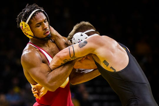 Iowa State's Sam Colbray, left, wrestles Iowa's Cash Wilcke at 184 during a NCAA Cy-Hawk series wrestling dual on Saturday, Dec. 1, 2018, at Carver-Hawkeye Arena in Iowa City.