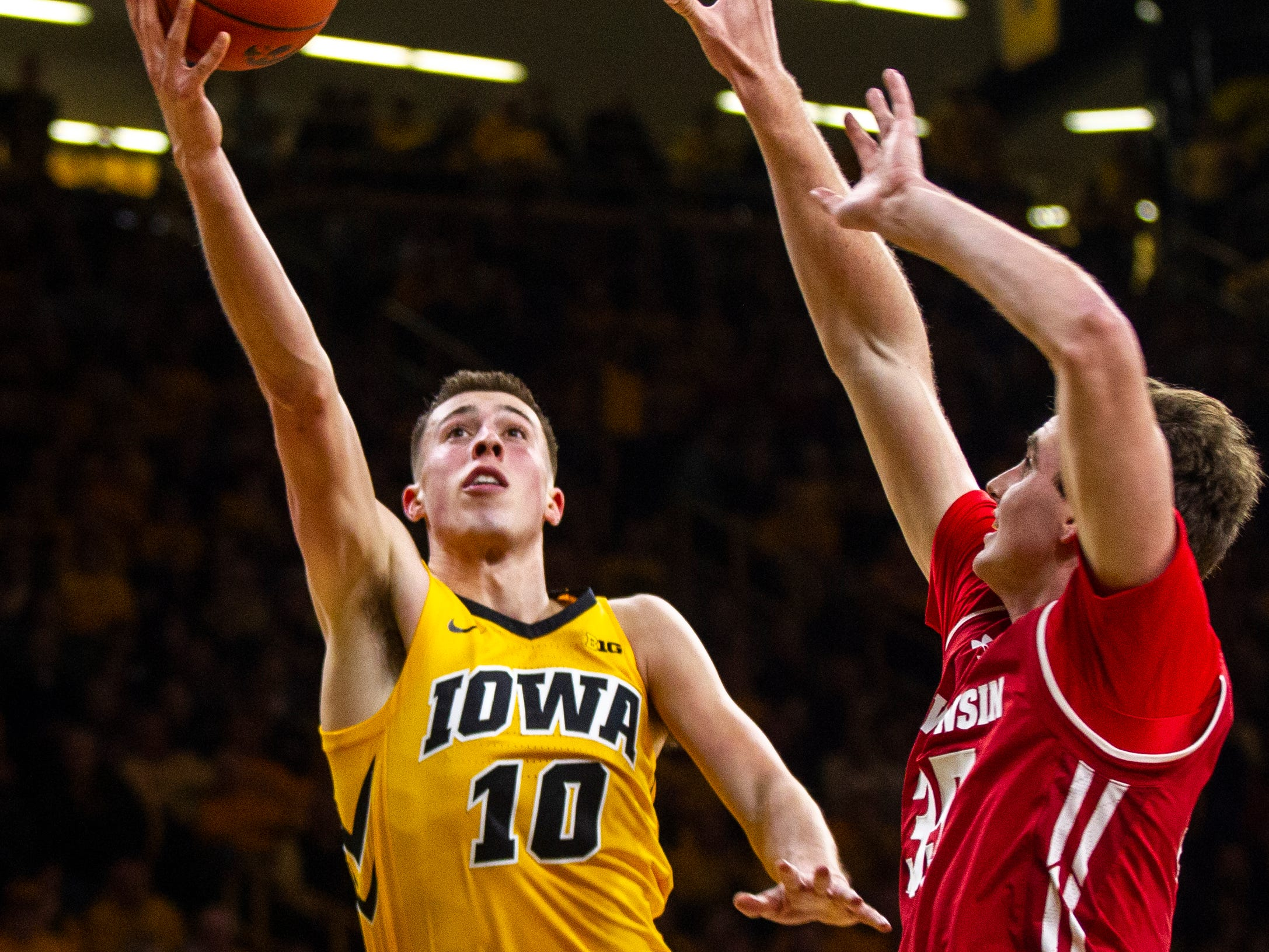 Iowa guard Joe Wieskamp (10) attempts a layup past Wisconsin's Nate Reuvers (35) during a NCAA Big Ten Conference men's basketball game on Friday, Nov. 30, 2018, at Carver-Hawkeye Arena in Iowa City.
