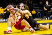Iowa's Spencer Lee, right, wrestles Iowa State's Alex Mackall at 125 during a NCAA Cy-Hawk series wrestling dual on Saturday, Dec. 1, 2018, at Carver-Hawkeye Arena in Iowa City.