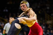 Iowa State's Austin Gomez, right, wrestles Iowa's Austin DeSanto at 133 during a NCAA Cy-Hawk series wrestling dual on Saturday, Dec. 1, 2018, at Carver-Hawkeye Arena in Iowa City.
