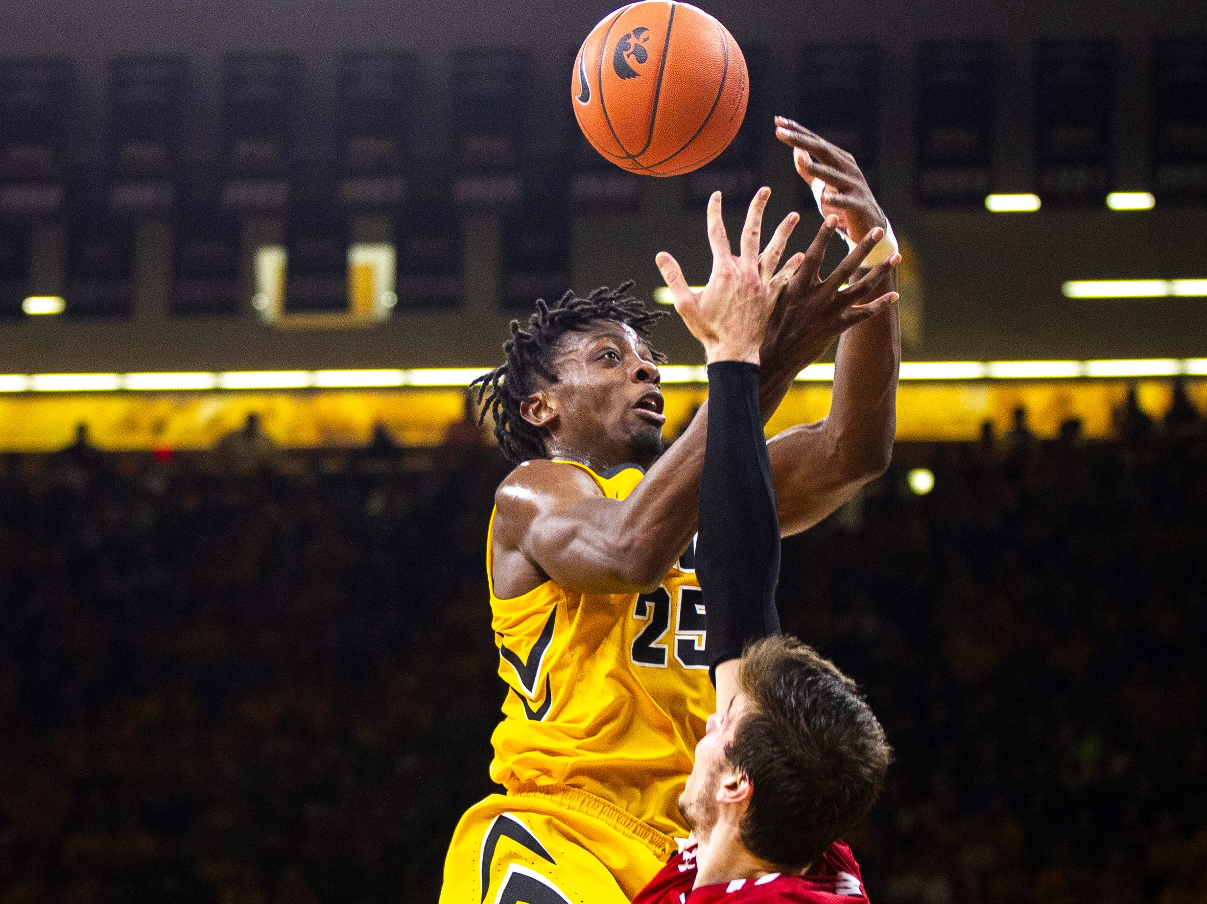 Iowa forward Tyler Cook (25) gets his shot blocked by Wisconsin's Ethan Happ during a NCAA Big Ten Conference men's basketball game on Friday, Nov. 30, 2018, at Carver-Hawkeye Arena in Iowa City.