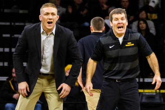 Iowa assistant coach Ryan Morningstar, left, and head coach Tom Brands call out during a NCAA Cy-Hawk series wrestling dual on Saturday, Dec. 1, 2018, at Carver-Hawkeye Arena in Iowa City.